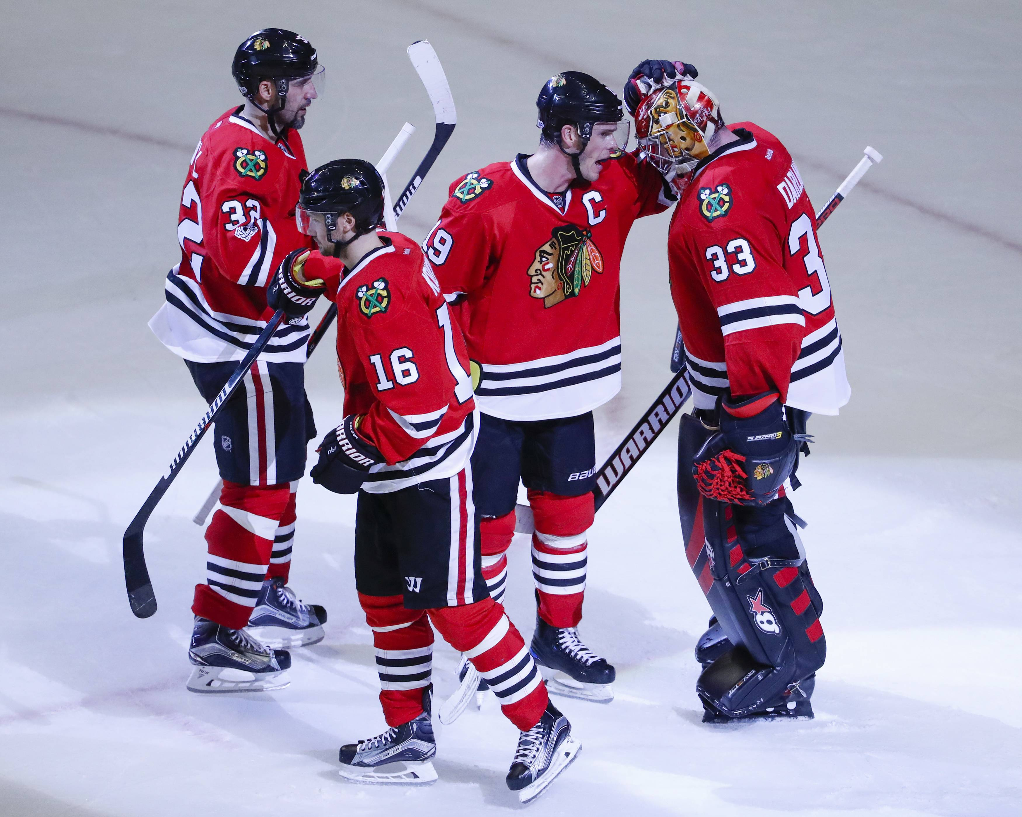 Chicago Blackhawks center Jonathan Toews (19) celebrates with goalie Scott Darling (33) their 4-2 win against the St. Louis Blues at the end of an NHL hockey game Sunday, Feb. 26, 2017, in Chicago. (AP Photo/Kamil Krzaczynski)