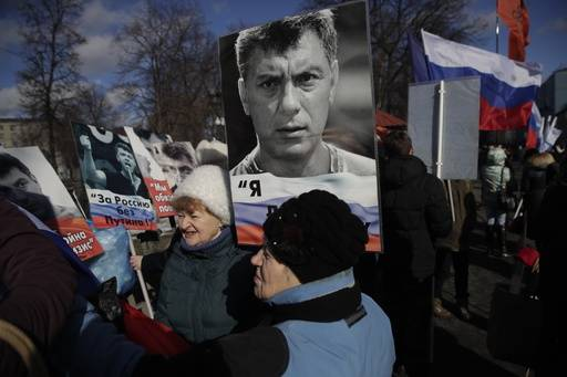 People gather together prior a march in memory of opposition leader Boris Nemtsov, who was killed two years ago, in Moscow, Russia, Sunday, Feb. 26, 2017. Several thousand people held a march in Moscow in memory of the Russian opposition leader to mark the second anniversary of his killing.