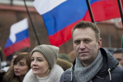 Russian opposition leader Alexei Navalny and his wife Yulia, second left, take part in a march in memory of opposition leader Boris Nemtsov in Moscow, Russia, Sunday, Feb. 26, 2017. Thousands of Russians take to the streets of downtown Moscow to mark two years since Nemtsov was gunned down outside the Kremlin.