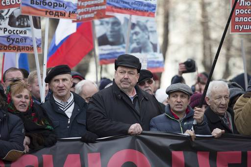 Russian former opposition lawmaker Gennady Gudkov, center, takes part in a march in memory of opposition leader Boris Nemtsov in Moscow, Russia, Sunday, Feb. 26, 2017. Thousands of Russians take to the streets of downtown Moscow to mark two years since Nemtsov was gunned down outside the Kremlin.