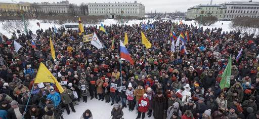 People gather in memory of opposition leader Boris Nemtsov in St. Petersburg, Russia, Sunday, Feb. 26, 2017. Thousands of Russians have taken to the streets of Moscow and St. Petersburg to mark two years since Nemtsov was gunned down outside the Kremlin.