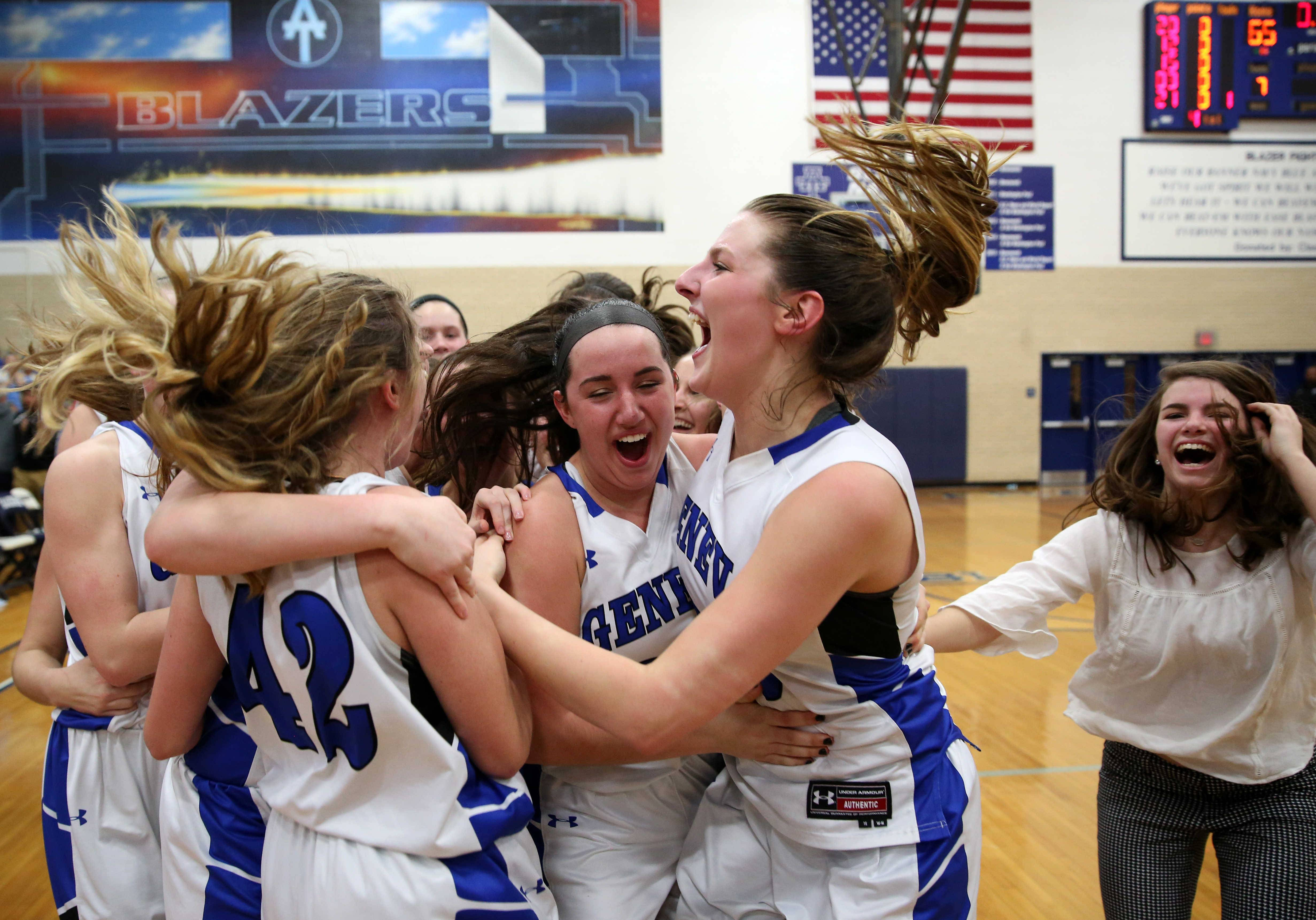 Geneva's Lady Vikings celebrate a win over Maine West during girls basketball supersectional action at Addison Trail High School Monday night.