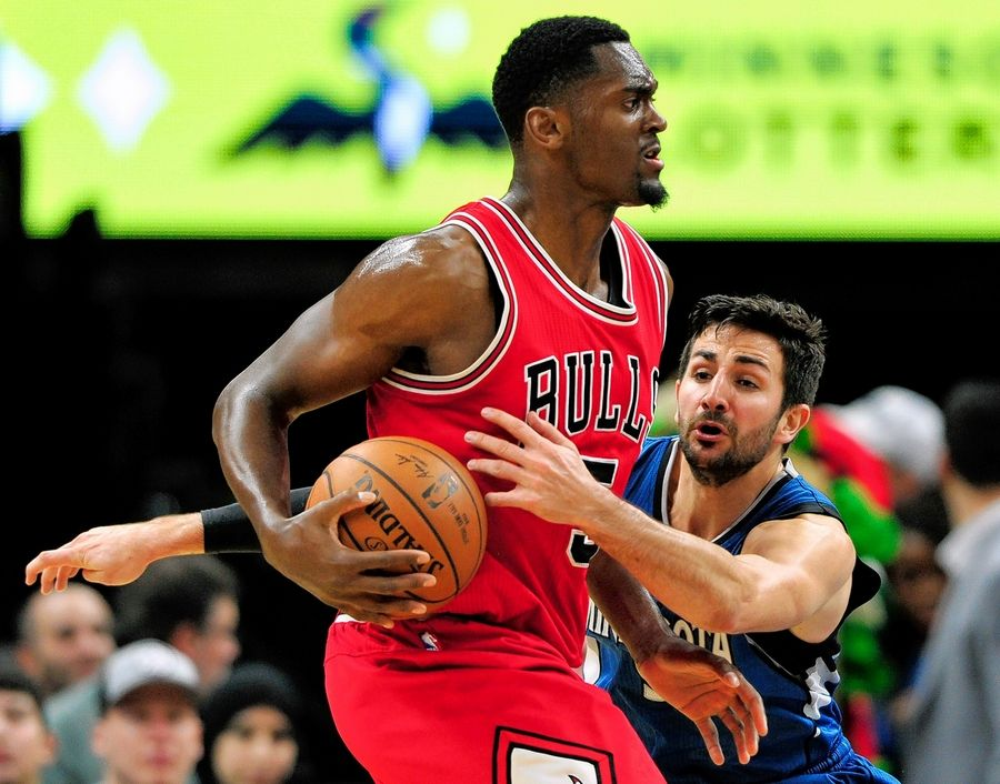 Chicago Bulls forward Bobby Portis, left, has the ball as Minnesota Timberwolves guard Ricky Rubio, of Spain, reaches during the fourth quarter of an NBA basketball game on Sunday, Feb. 12, 2017, in Minneapolis. The Timberwolves won 117-89.