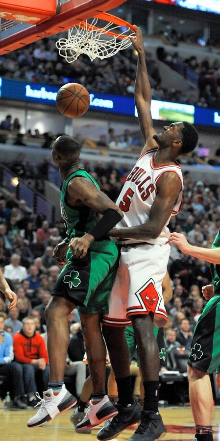 Chicago Bulls' Bobby Portis (5) dunks against Boston Celtics' Al Horford (42) during the first half of an NBA basketball game Thursday, Feb. 16, 2017, in Chicago. Chicago won 104-103.