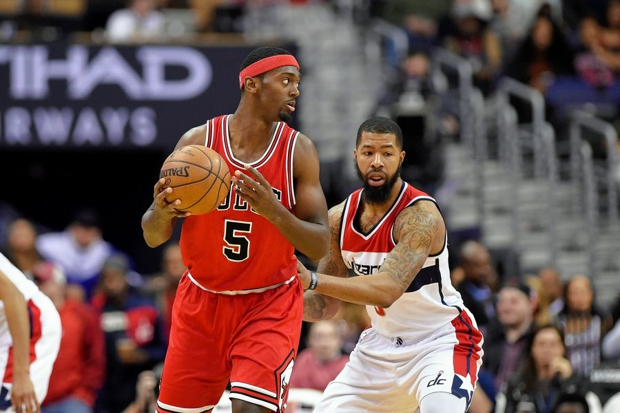 Chicago Bulls forward Bobby Portis, left, holds the ball against Washington Wizards forward Markieff Morris, right, during the first half of an NBA basketball game, Tuesday, Jan. 10, 2017, in Washington.