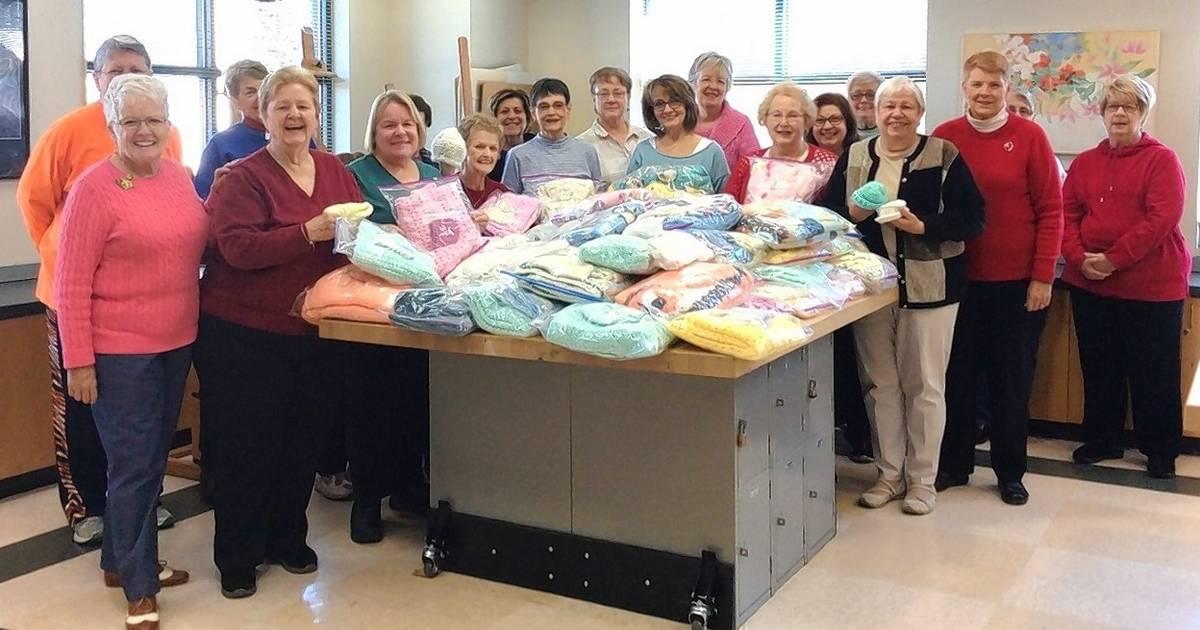 senior center knitters help keep babies warm