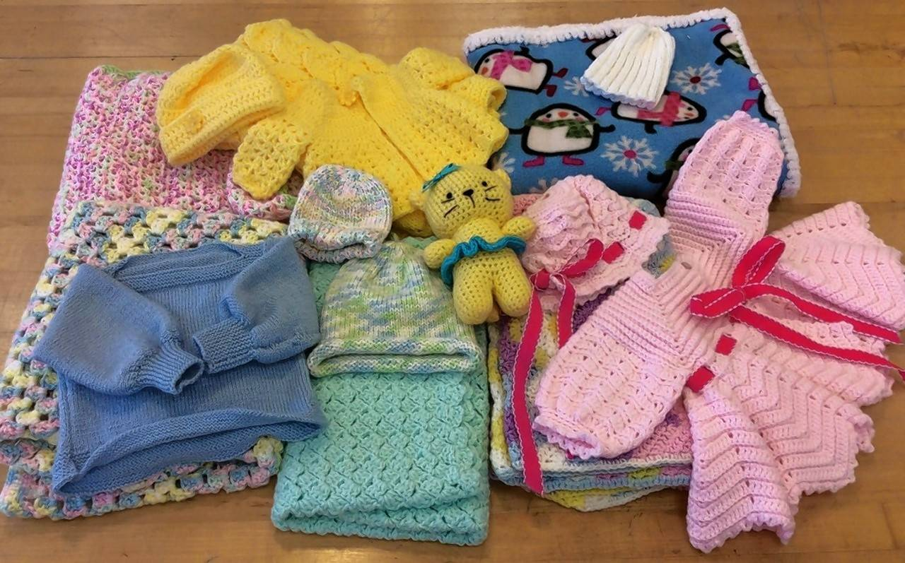 Sixty sets of blankets, sweaters, caps and toys, all made by the members of the AHPD knitting and crocheting program, will grace the layettes INFANT, Inc. distributes to new mothers in need.