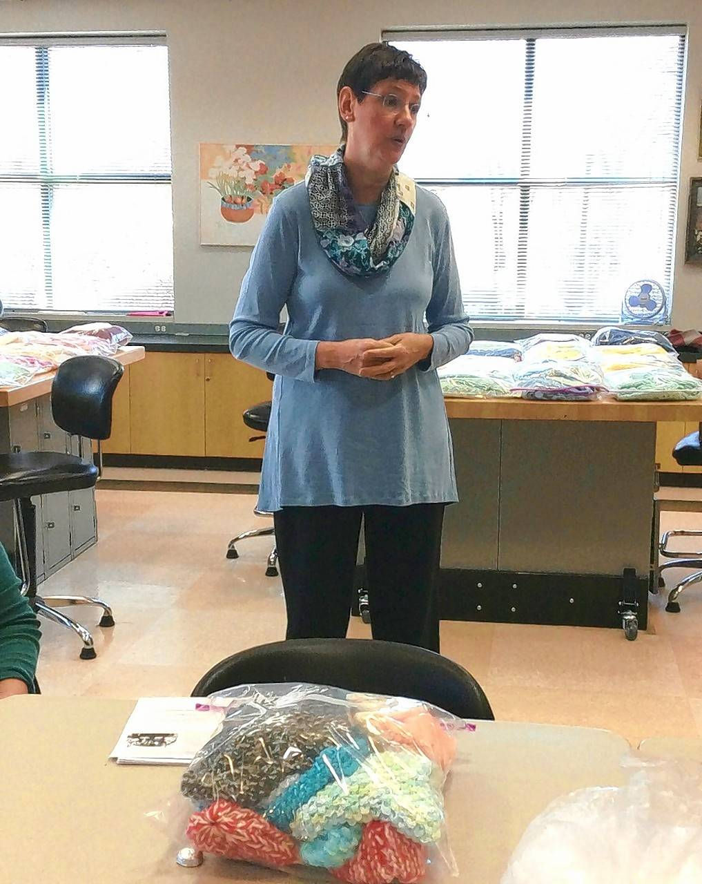 Anna Hoffman readies the handmade baby items for delivery to INFANT, Inc.