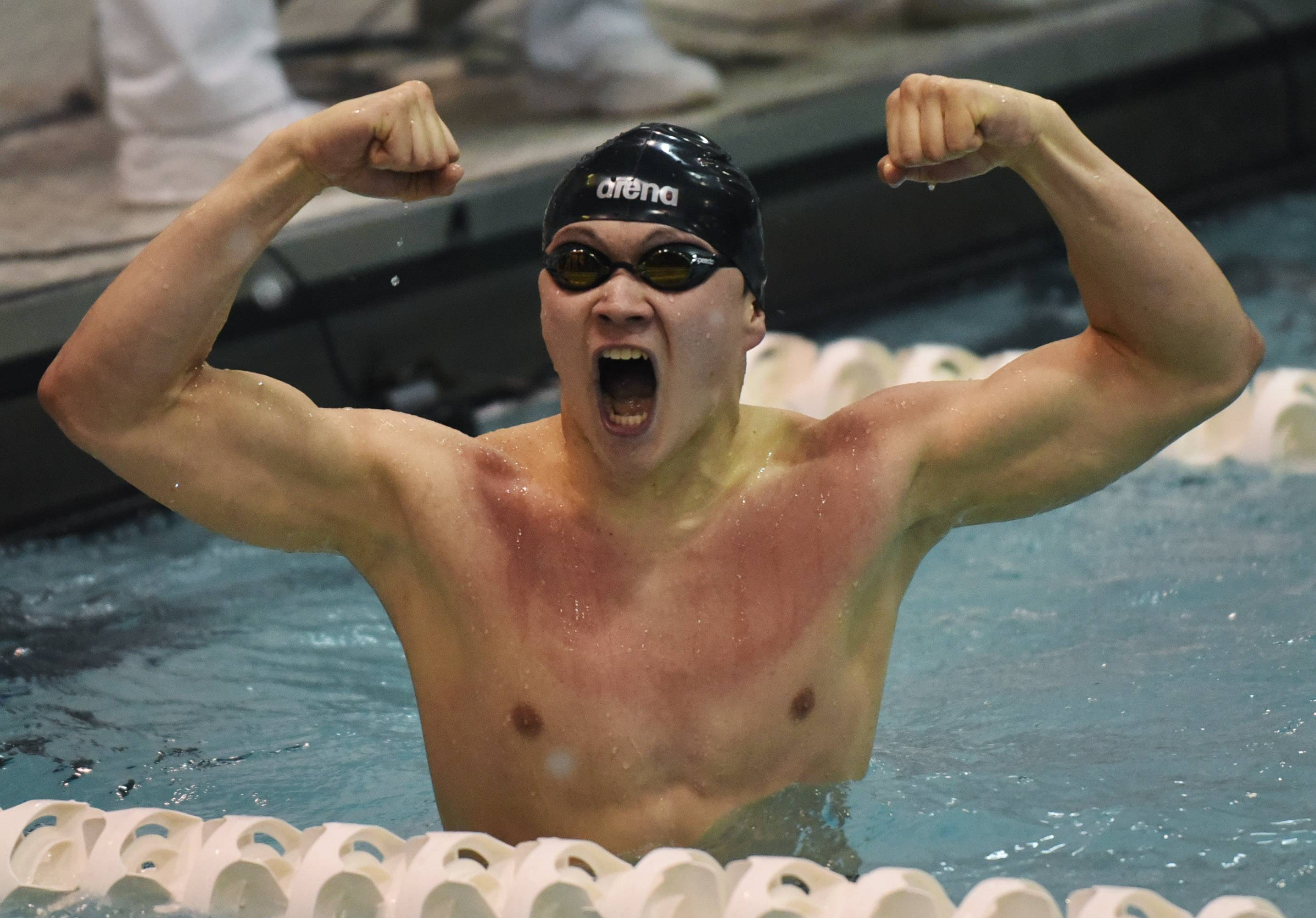 Glenbrook South's Sam Iida celbrates after breaking his own state record in the 200-yard individual medley with a time of 1:46.02 during the boys swimming state finals at New Trier High School in Winnetka Saturday.