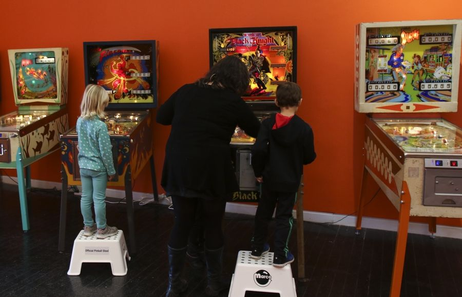 "Visitors can play the pinball machines at ""Kings and Queens: Pinball, Imagists and Chicago,"" an exhibit running through May 7 at the Elmhurst Art Museum."