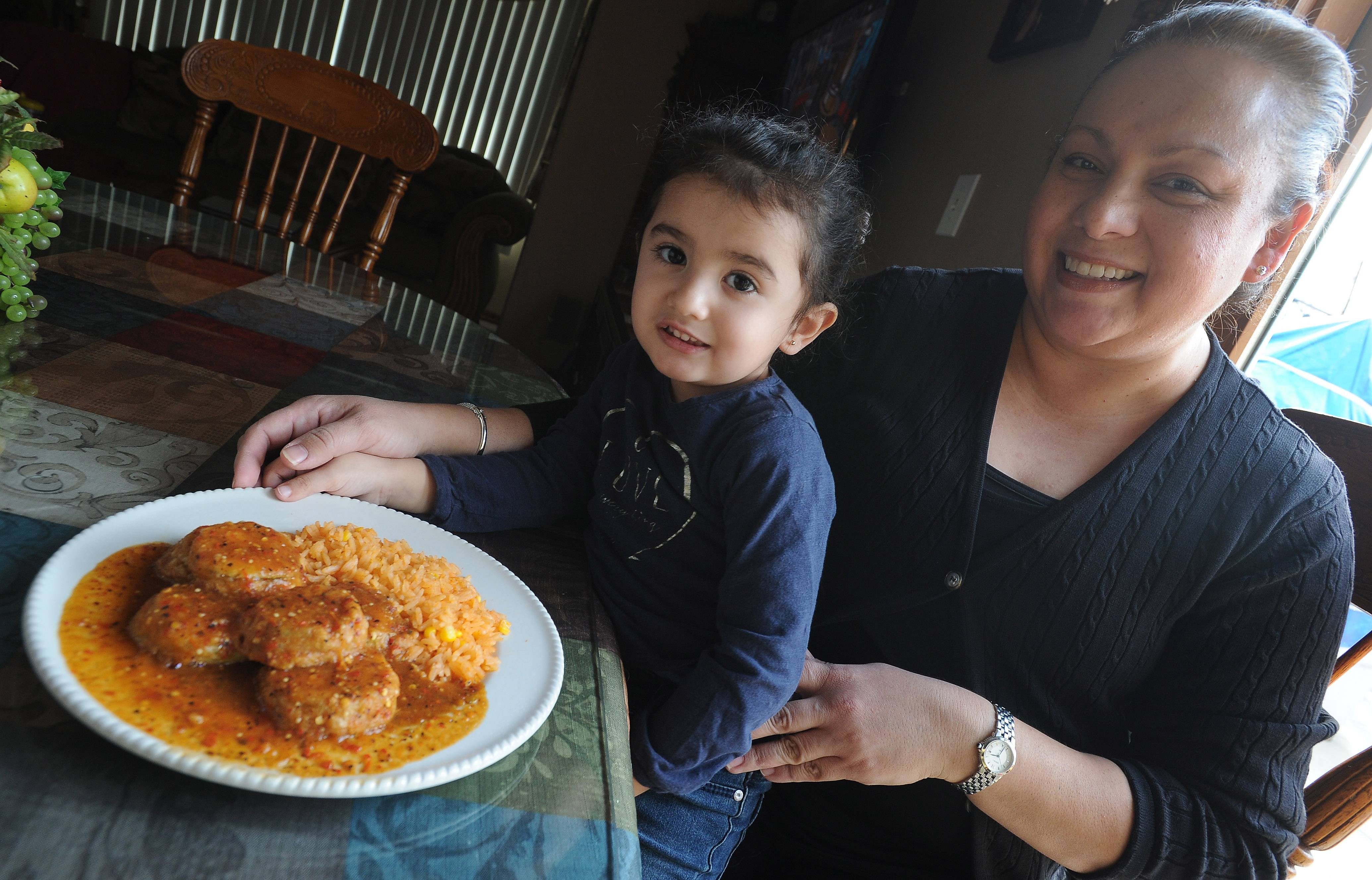 Norma Lara with her special dish the Tortitas de Calabaza she makes for her family and her granddaughter Mariana Lara, 2, in her Palatine home.