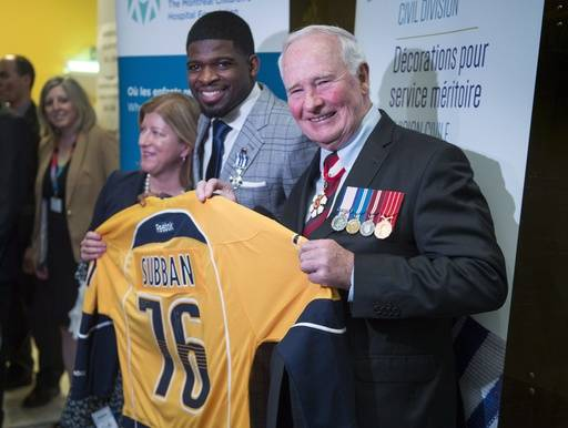 Nashville Predators P.K. Subban presents Gov. Gen. David Johnston with a team jersey during a ceremony, Wednesday, March 1, 2017 in Montreal. Subban received the Governor General Meritorious Service Decoration. (Paul Chiasson/The Canadian Press via AP)