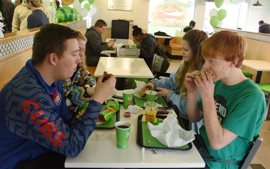 Fremd High School students, from left, Travis Ligon and Abbie Stelnecki, both of Palatine, and Alyssa Plank and Kaleb Scharman of Rolling Meadows have lunch together at Nic's Organic Fast Food, the nation's first QAI-certified organic drive-through Thursday in Rolling Meadows.