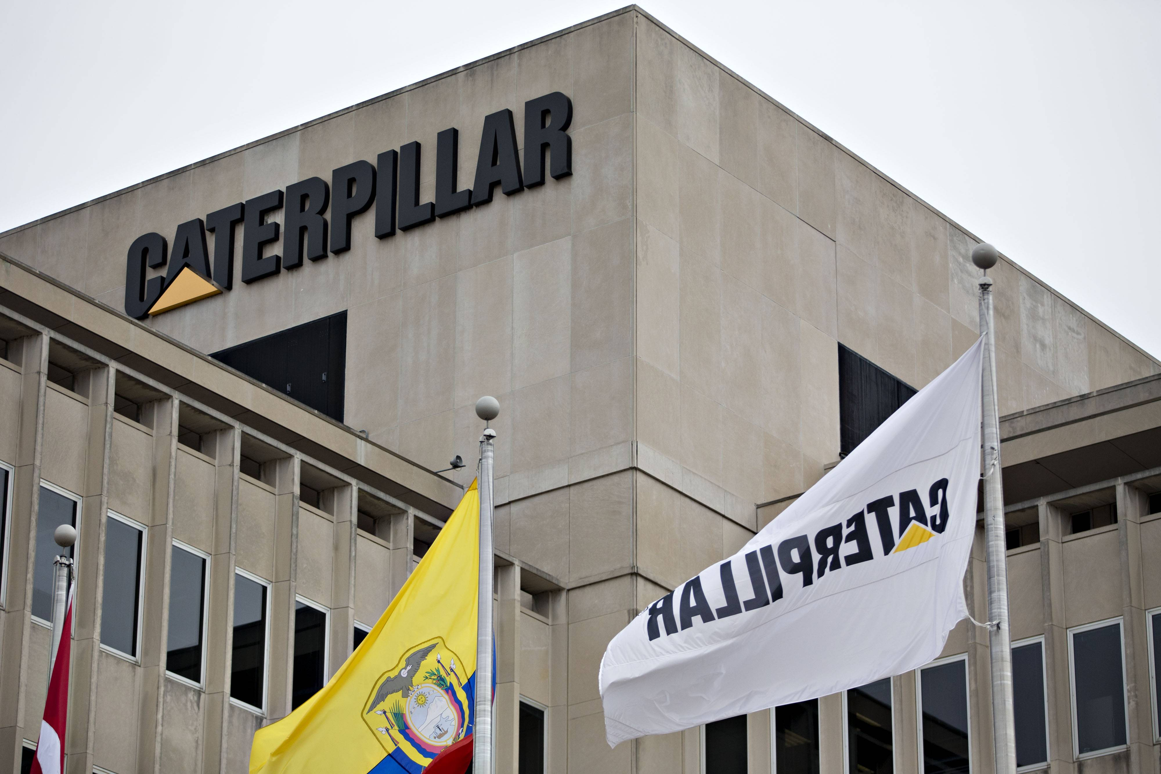 Caterpillar Inc. shares headed for the steepest decline in eight months as the biggest maker of machinery for mining and construction had three downstate offices raided by U.S. tax and financial agents.