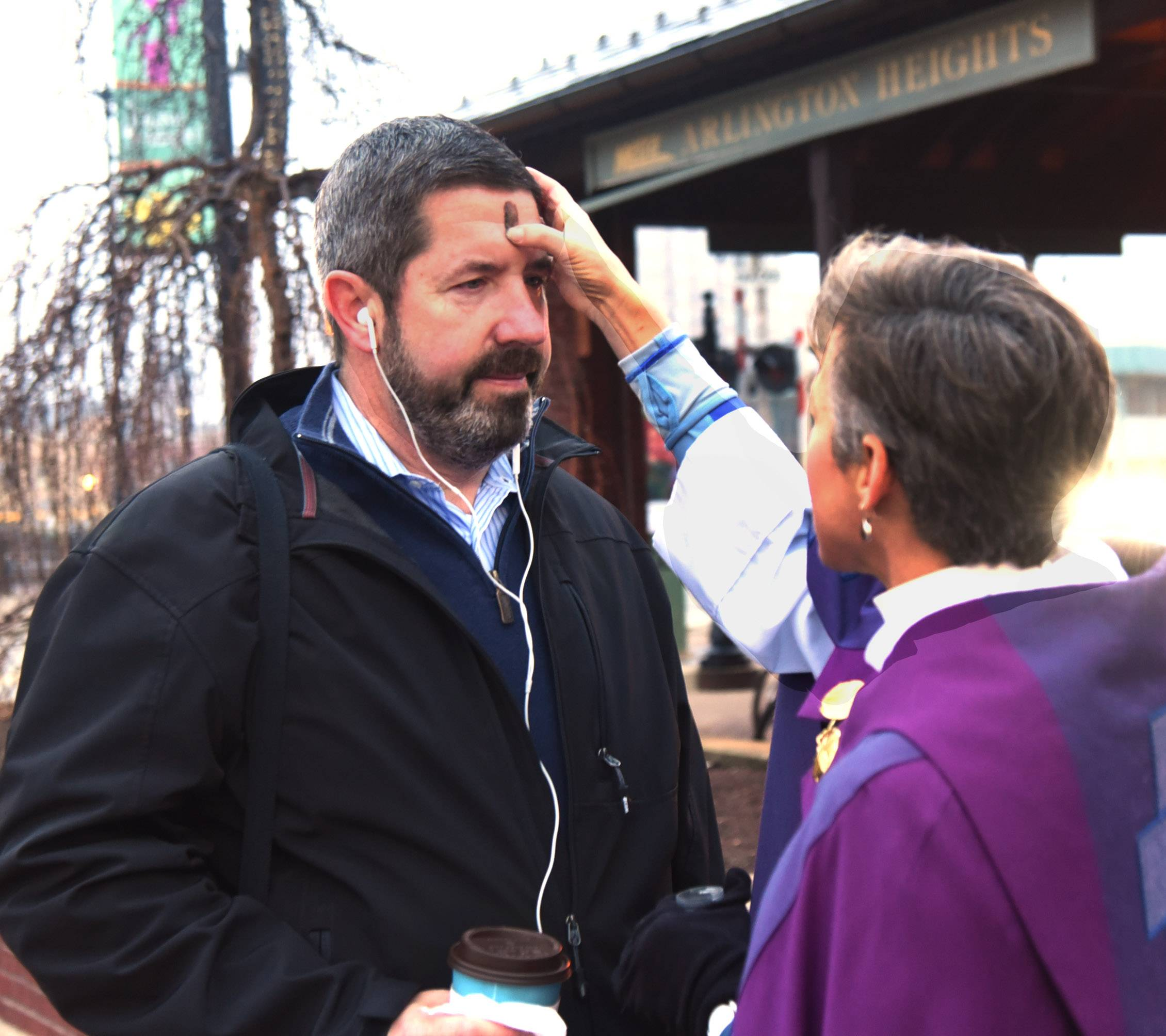 Observing the start of Lent by partaking in the ash ritual Wednesday at the Arlington Heights Metra Station, Dan Rooney of Arlington Heights receives ashes from the Rev. Elizabeth Jameson of St. Simon's Episcopal Church in Arlington Heights.