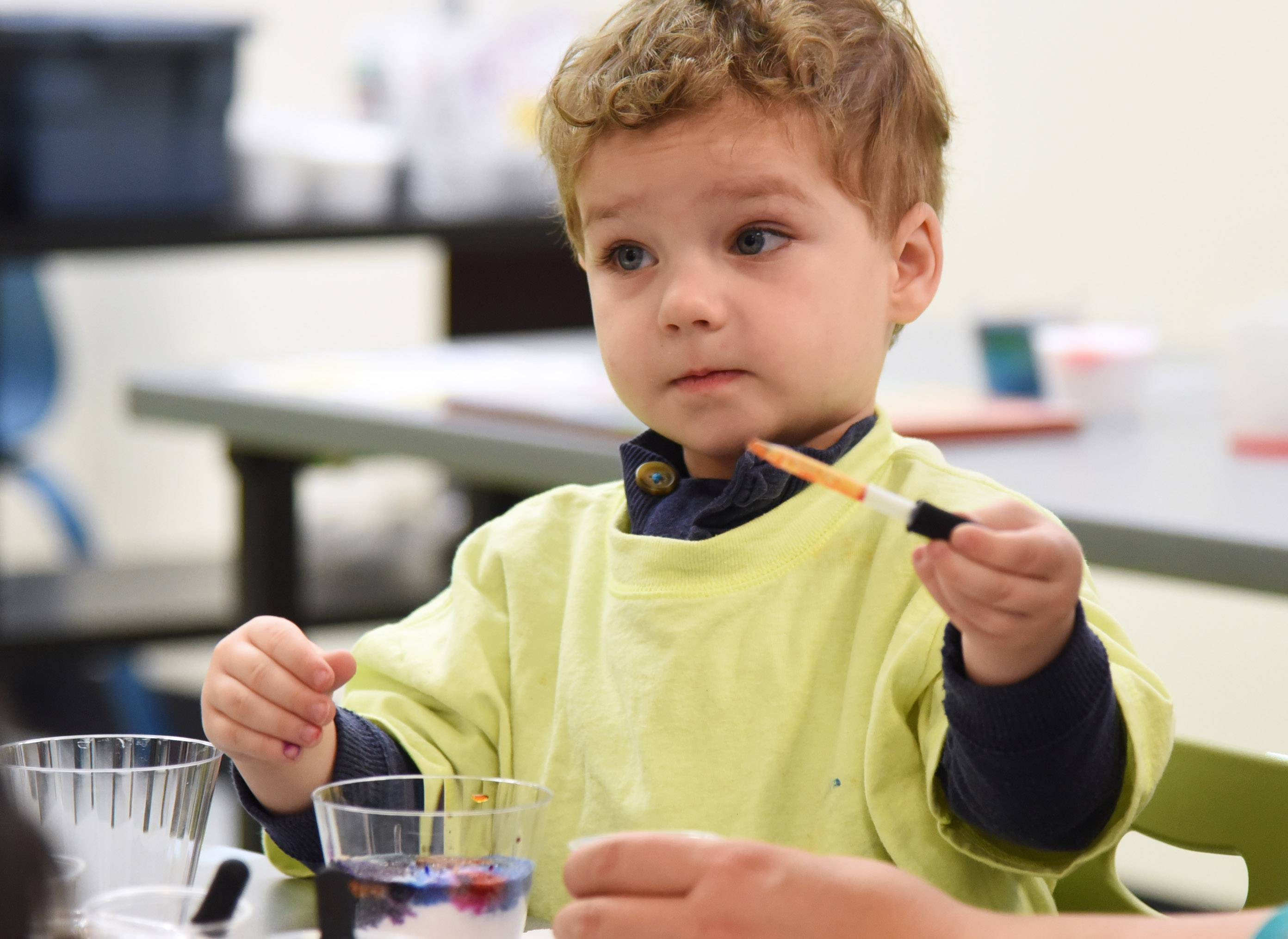 Two-year-old Griffin Groszczyk of Grayslake makes an art piece using a cup of salt and drops of watercolor during Friday's WonderArt program at Grayslake Area Public Library.