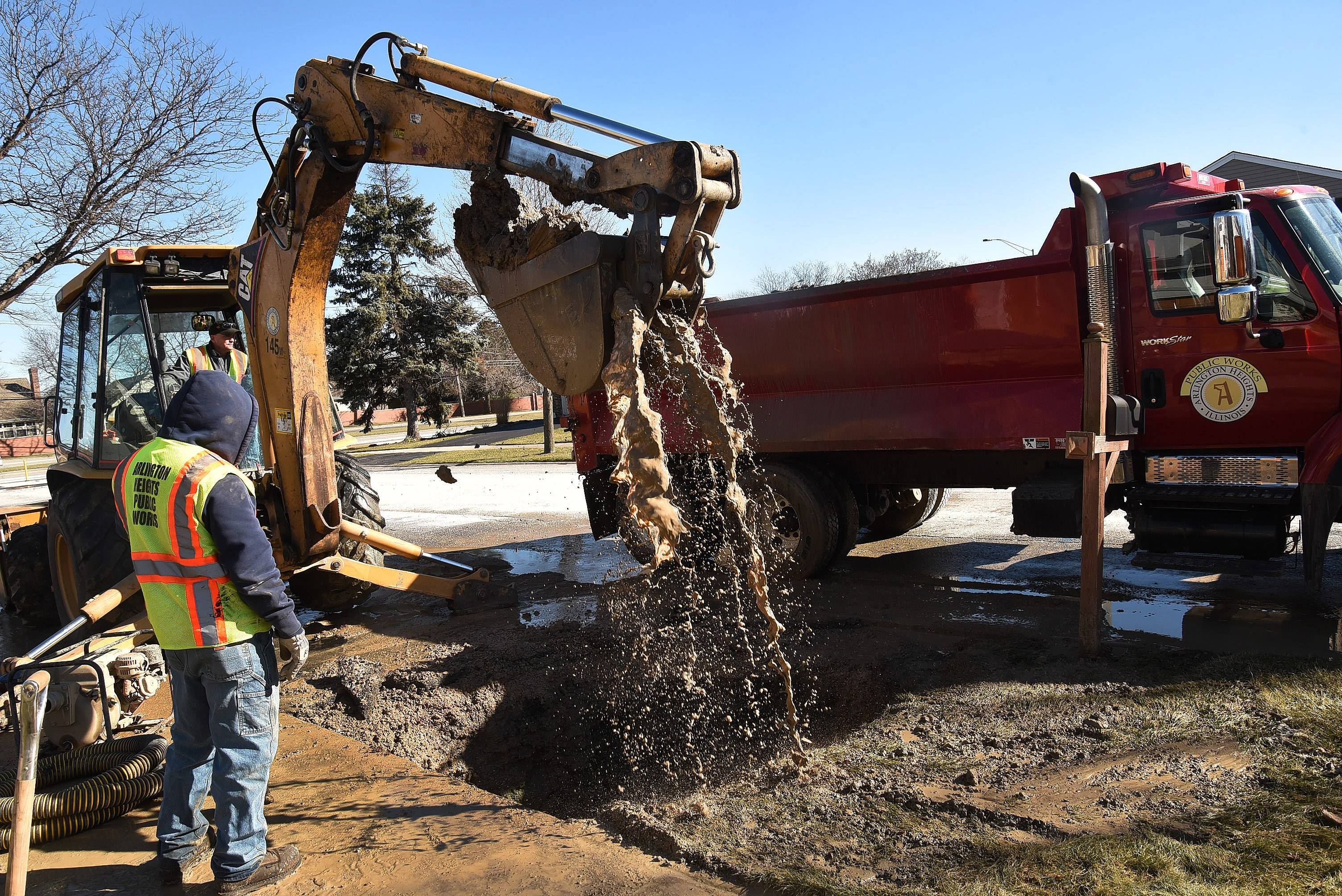Arlington Heights public works crews fix a water main break Friday morning at Highland Avenue and Palatine Frontage Road.