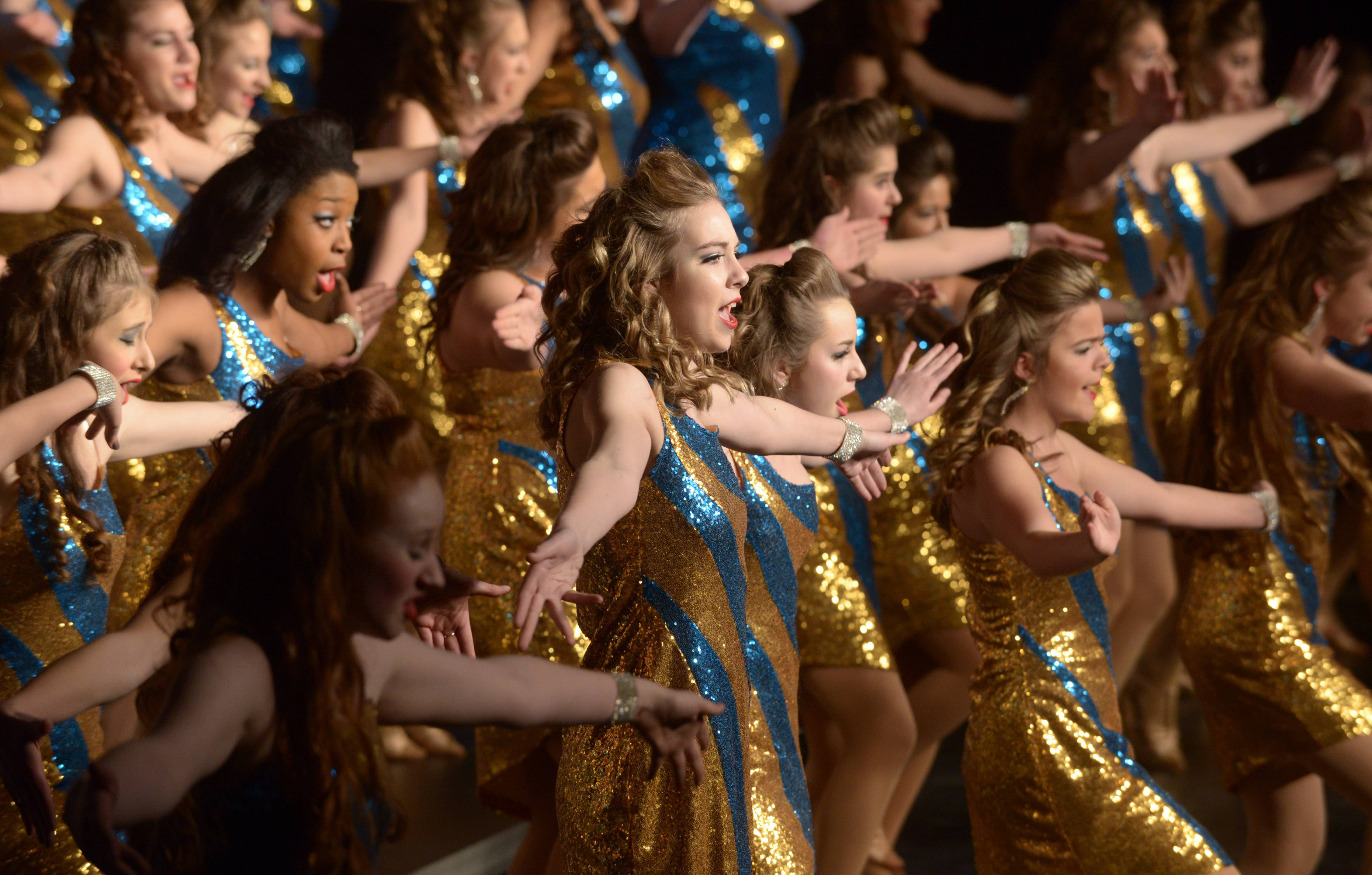 Naperville North's High Heeled Harmony performs during the 24th annual Chicagoland Showcase showchoir competition at John Hersey High School in Arlington Heights Saturday.