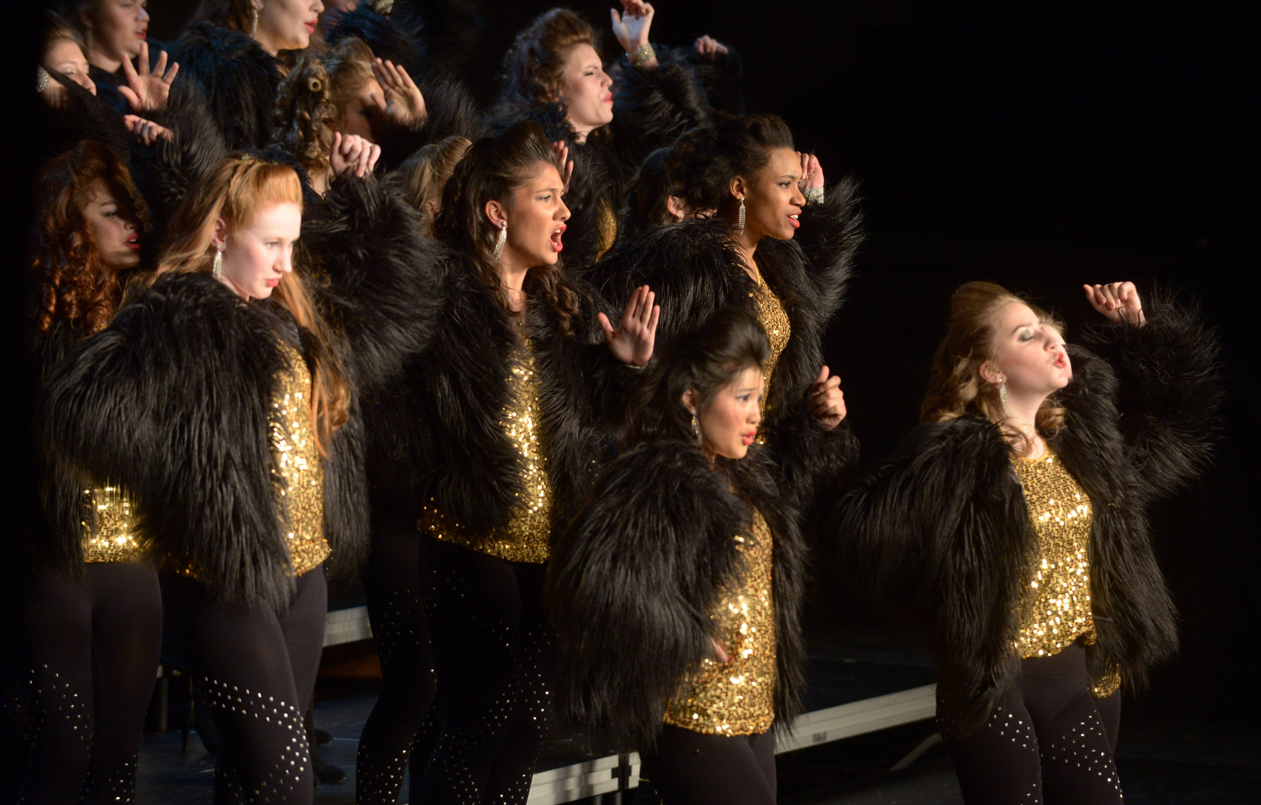Joe Lewnard/jlewnard@dailyherald.comNaperville North's High Heeled Harmony performs during the 24th annual Chicagoland Showcase showchoir competition at John Hersey High School in Arlington Heights Saturday.