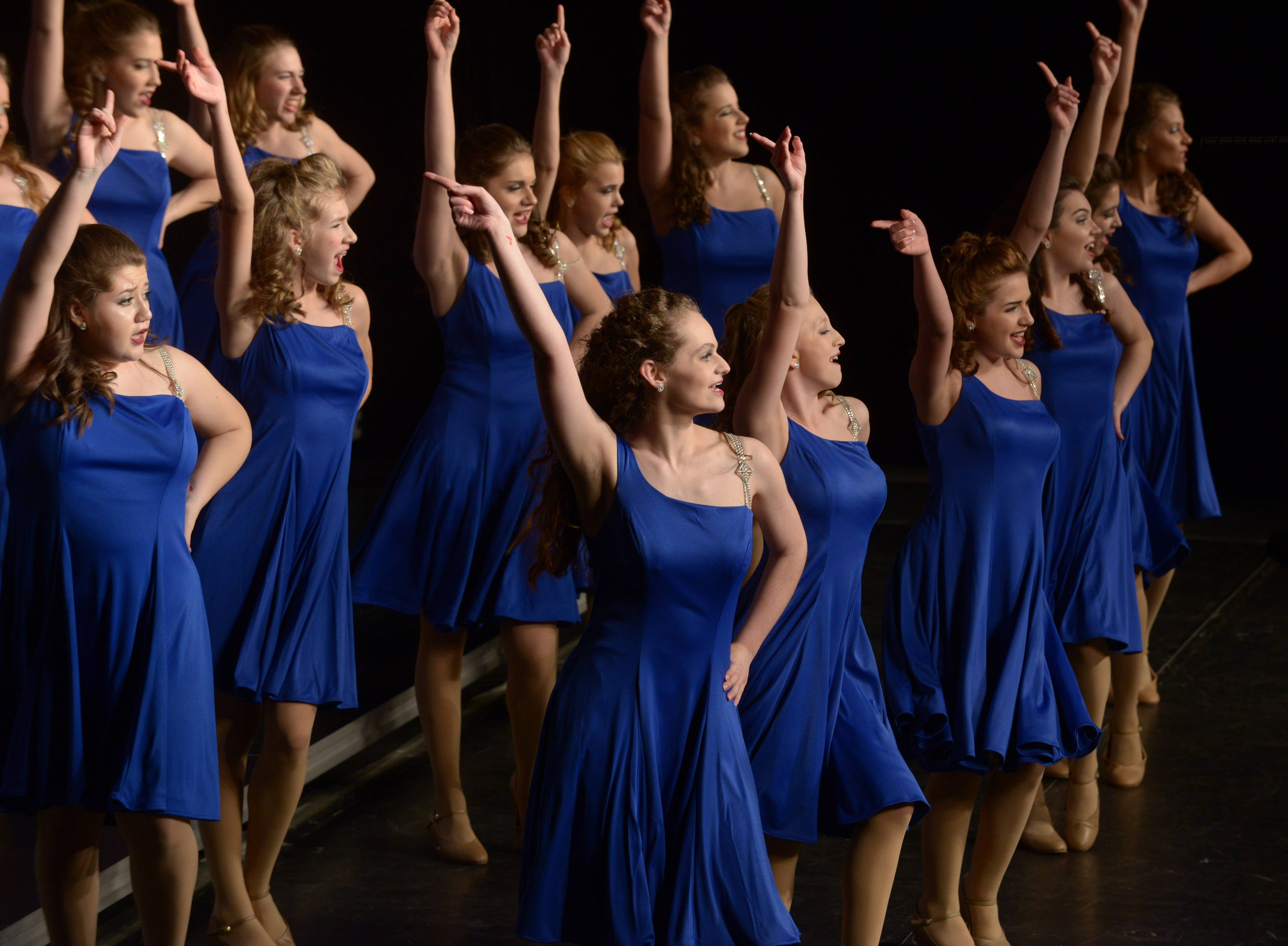 Batavia High School's Legacy performs during the 24th annual Chicagoland Showcase showchoir competition at John Hersey High School in Arlington Heights Saturday.