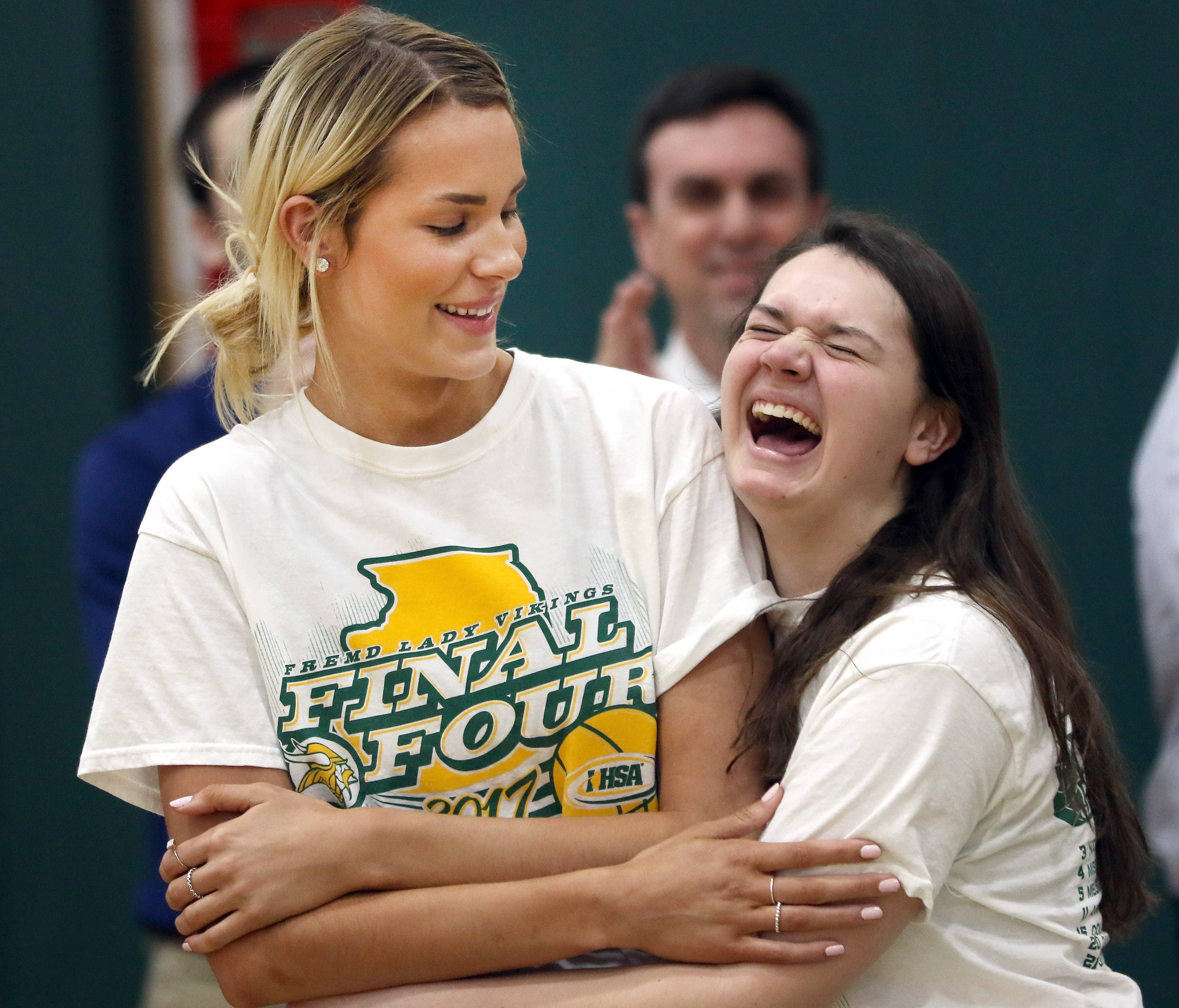 Fremd High School basketball players Grace Tworek, left, and Alyssa Honickel joke around during a school assembly Monday celebrating the team's fourth-place finish in the Class 4A state finals.