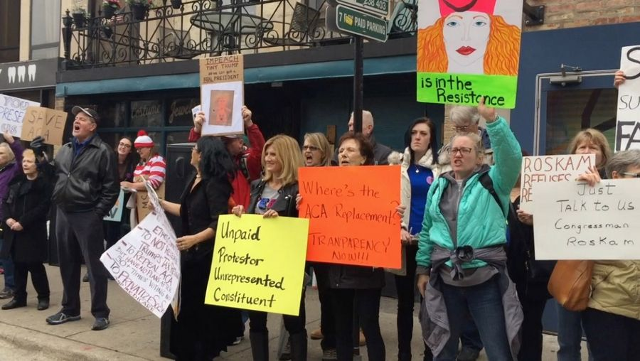 Protesters gathered Monday outside Maggiano's Banquets in Chicago, where Rep. Peter Roskam was speaking.