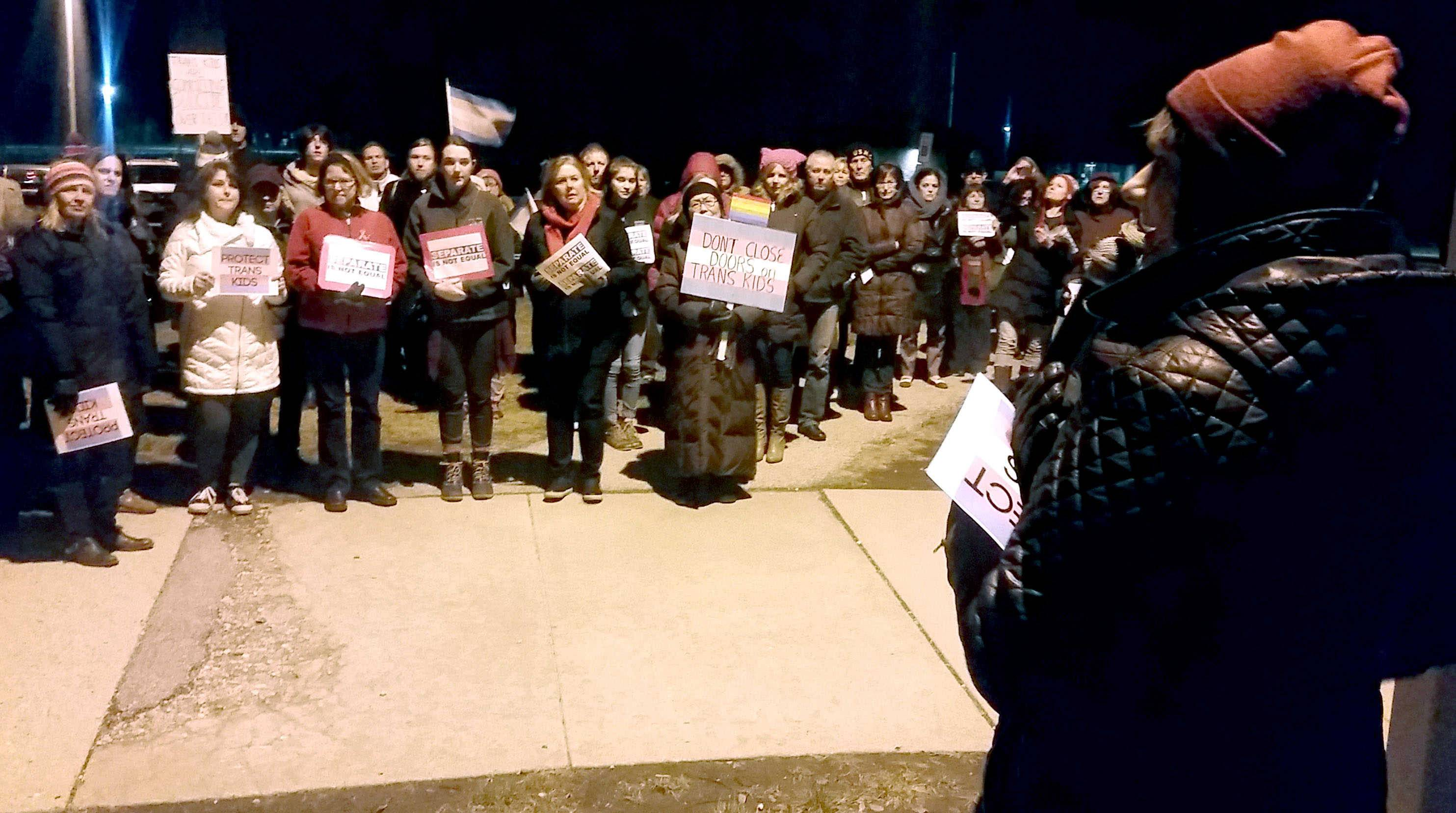 A group of about 150 people came to support transgender students in Palatine Township Elementary District 15 outside Walter R. Sundling Jr. High Wednesday night. Here, Gearah Goldstein, a transgender woman, addresses the group.