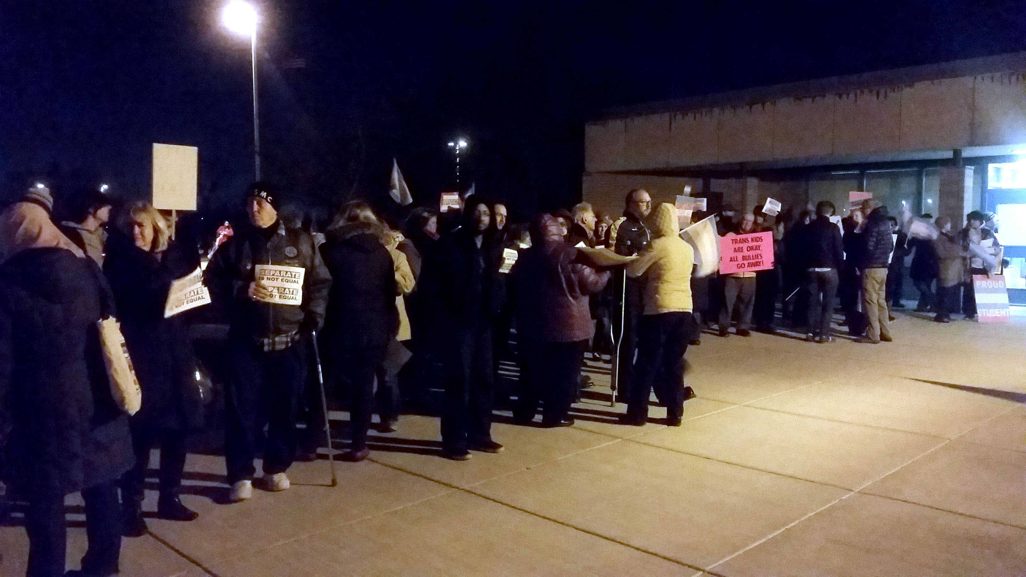 A group of around 150 people came to support transgender students in Palatine Township Elementary District 15 outside Walter R. Sundling Jr. High Wednesday night.