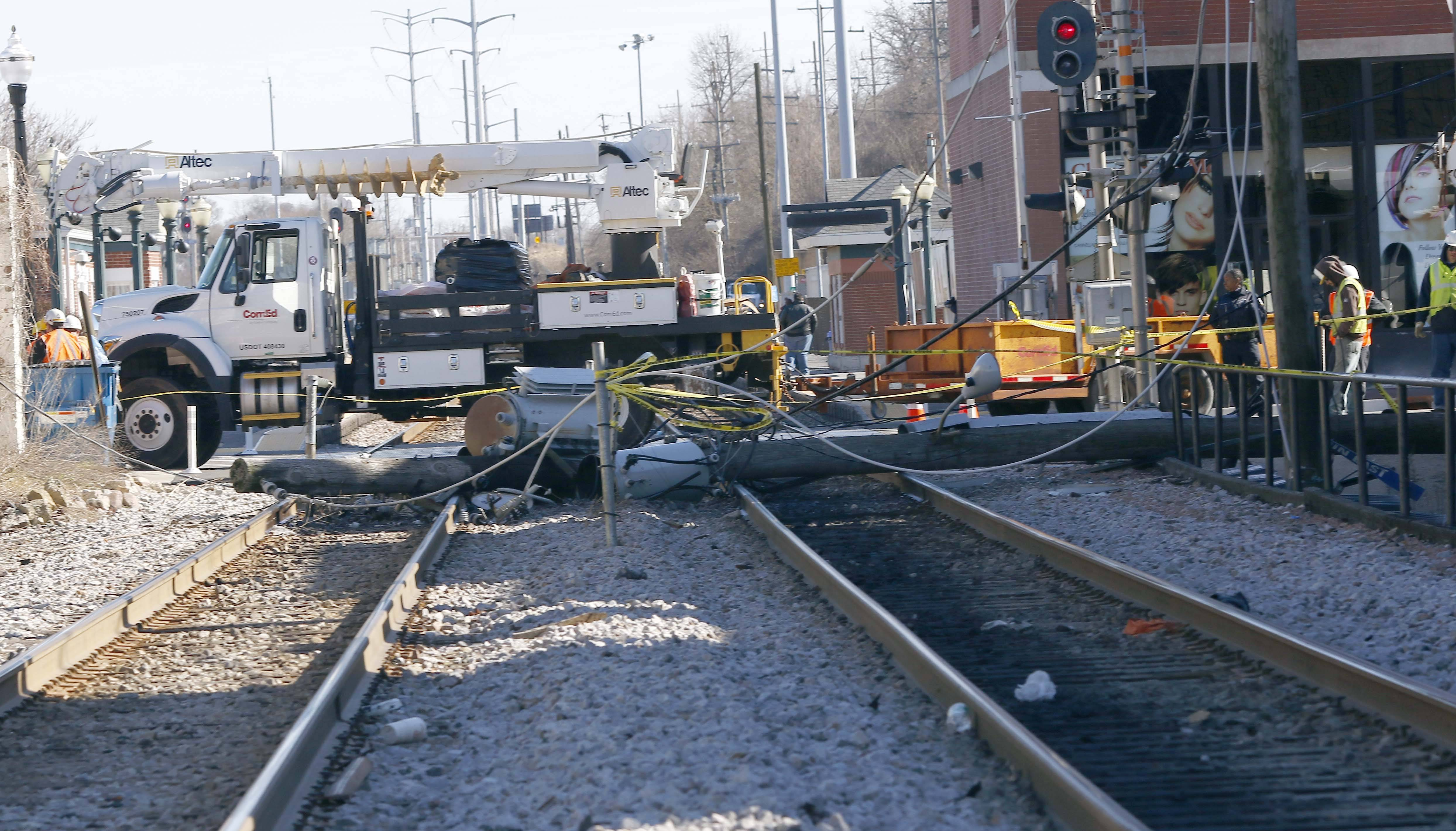 ComEd crews were at the scene of a downed power line on the Metra railroad tracks near the Elgin train station Wednesday.