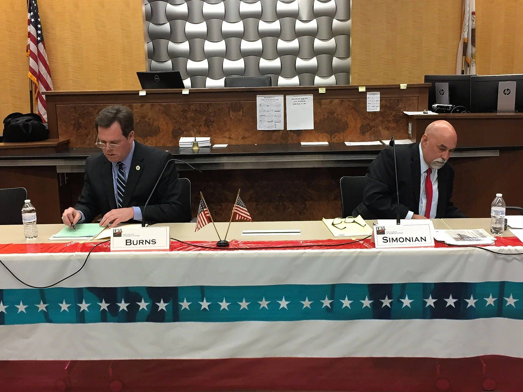 Geneva Mayor Kevin Burns, left, and opponent Alderman Tom Simonian, prepare for their questioning at a League of Women Voters Central Kane County forum Tuesday.