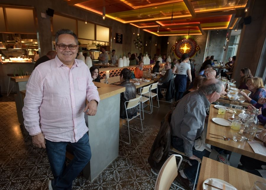 Richard Garcia-Rubio, chief culinary officer and partner, oversees the first dinner crowd Wednesday at Quiubo, a Mexican restaurant that is the first of five eateries to open in the Water Street District in downtown Naperville.