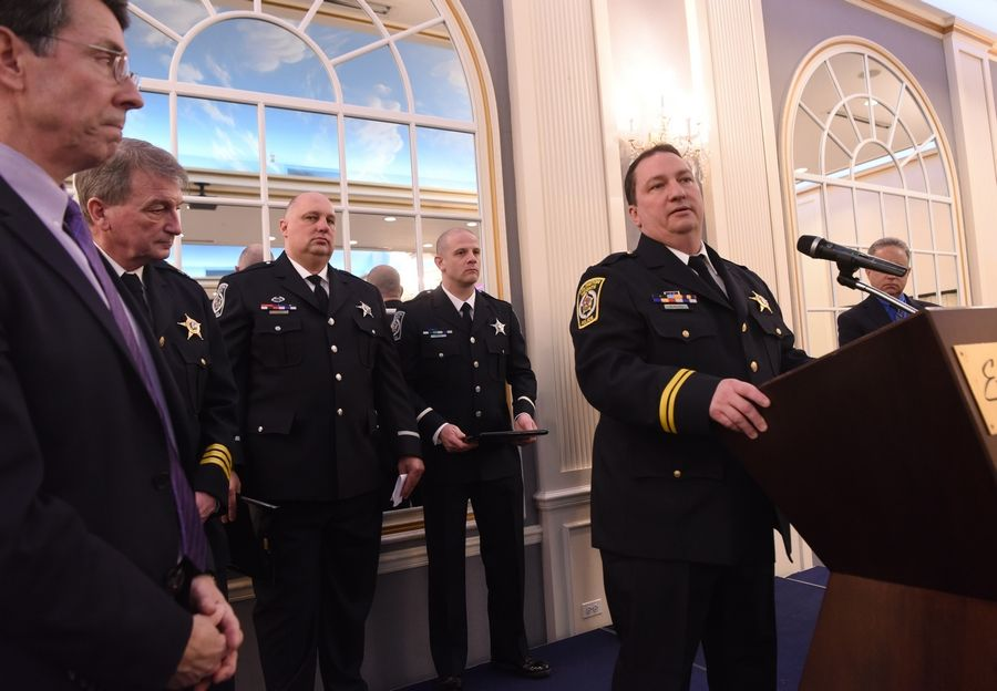 Cmdr. Mark Recker, who runs the Arlington Heights Police Department's Traffic Bureau, thanks the crowd after the bureau received the Officer of the Year Award. The award was presented Thursday at a Rotary Club luncheon at European Crystal Banquet and Conference Center.