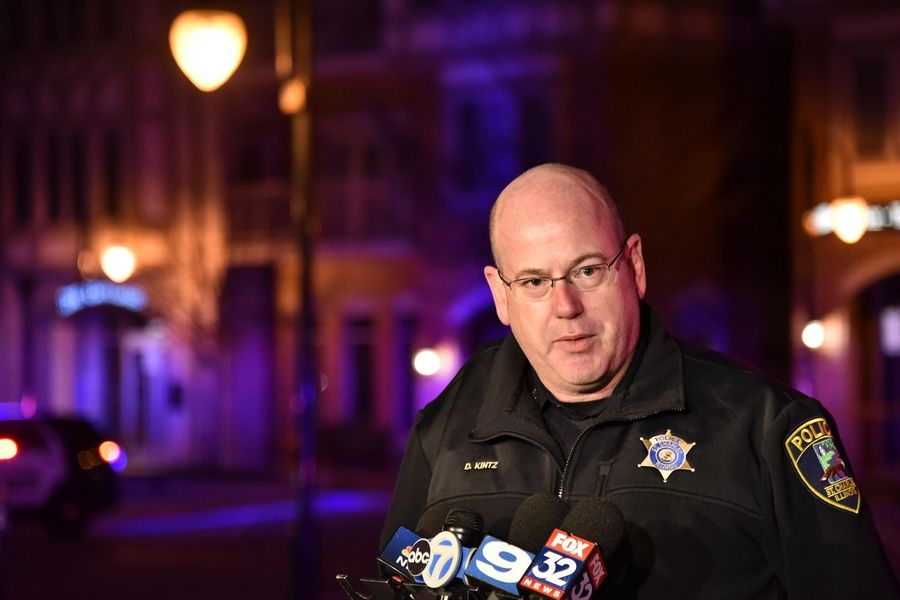 St. Charles Deputy Police Chief David Kintz speaks to reporters on the scene of the shootings Friday night on First Street in St. Charles.