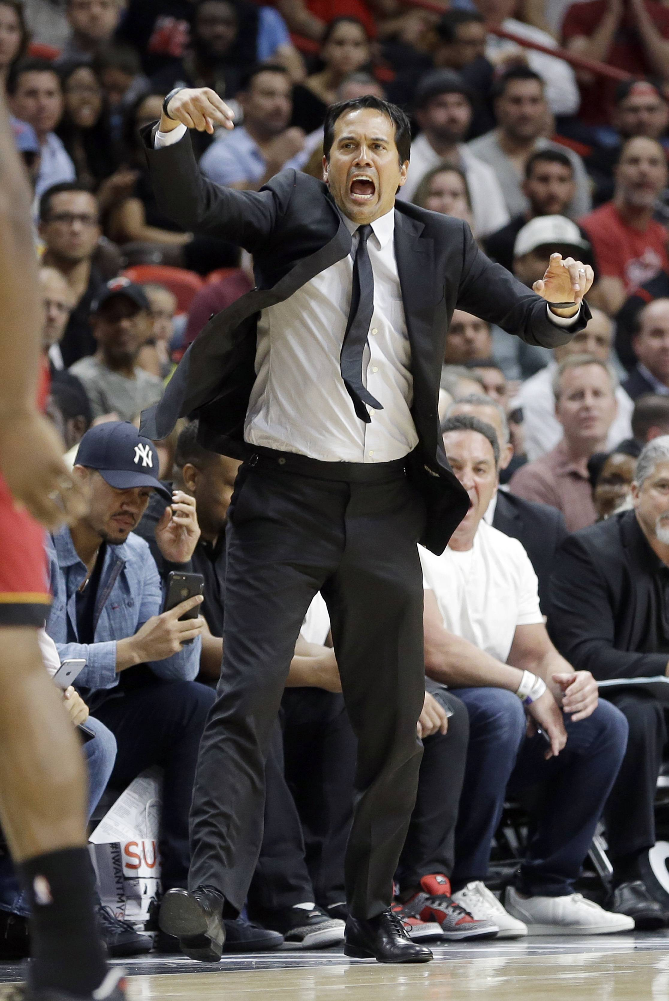 Miami Heat head coach Erik Spoelstra shouts instructions to his players against the Charlotte Hornets in the second half of an NBA basketball game, Wednesday, March 8, 2017, in Miami. The Heat won 108-101.