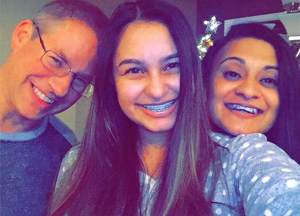 Randy Coffland, left, daughter Brittany and his wife, Anjum.