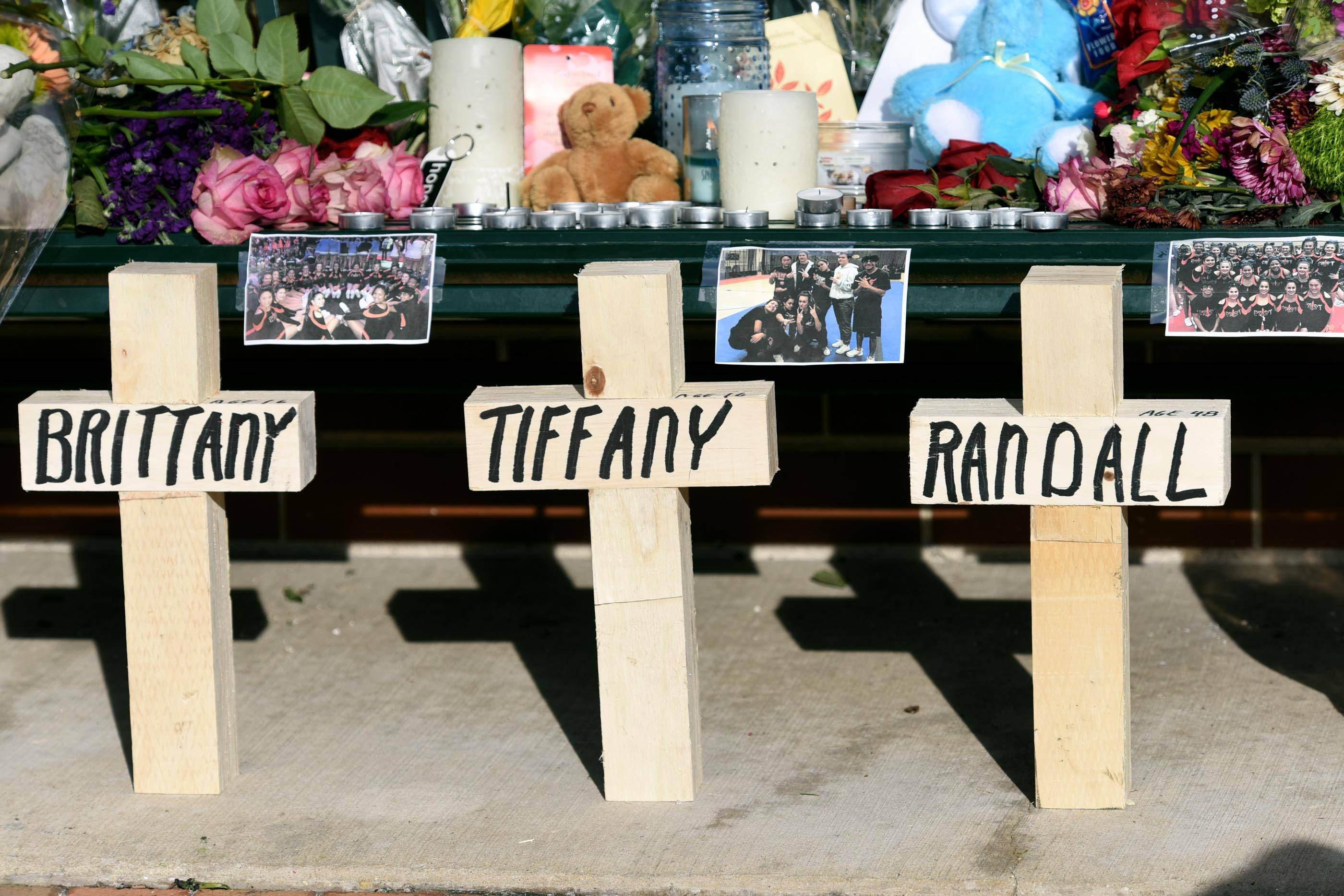 Crosses with the victim's names and photos were added to the memorial near the scene of a quadruple shooting in downtown St. Charles.