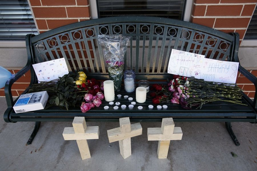 A memorial sits outside the scene where four people were shot in St. Charles, police say. Officers were called to a condominium complex on the 400 block of South First Street at about 5 p.m. Friday after several 911 calls -- including one from inside the condo -- about shots fired, according to Deputy Chief David Kintz.