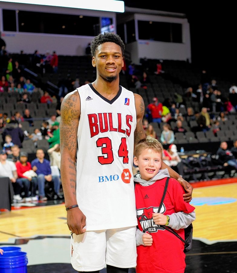 Alfonso McKinnie, shown here with a young fan, grew up in Chicago and has spent this season with the Windy City Bulls.