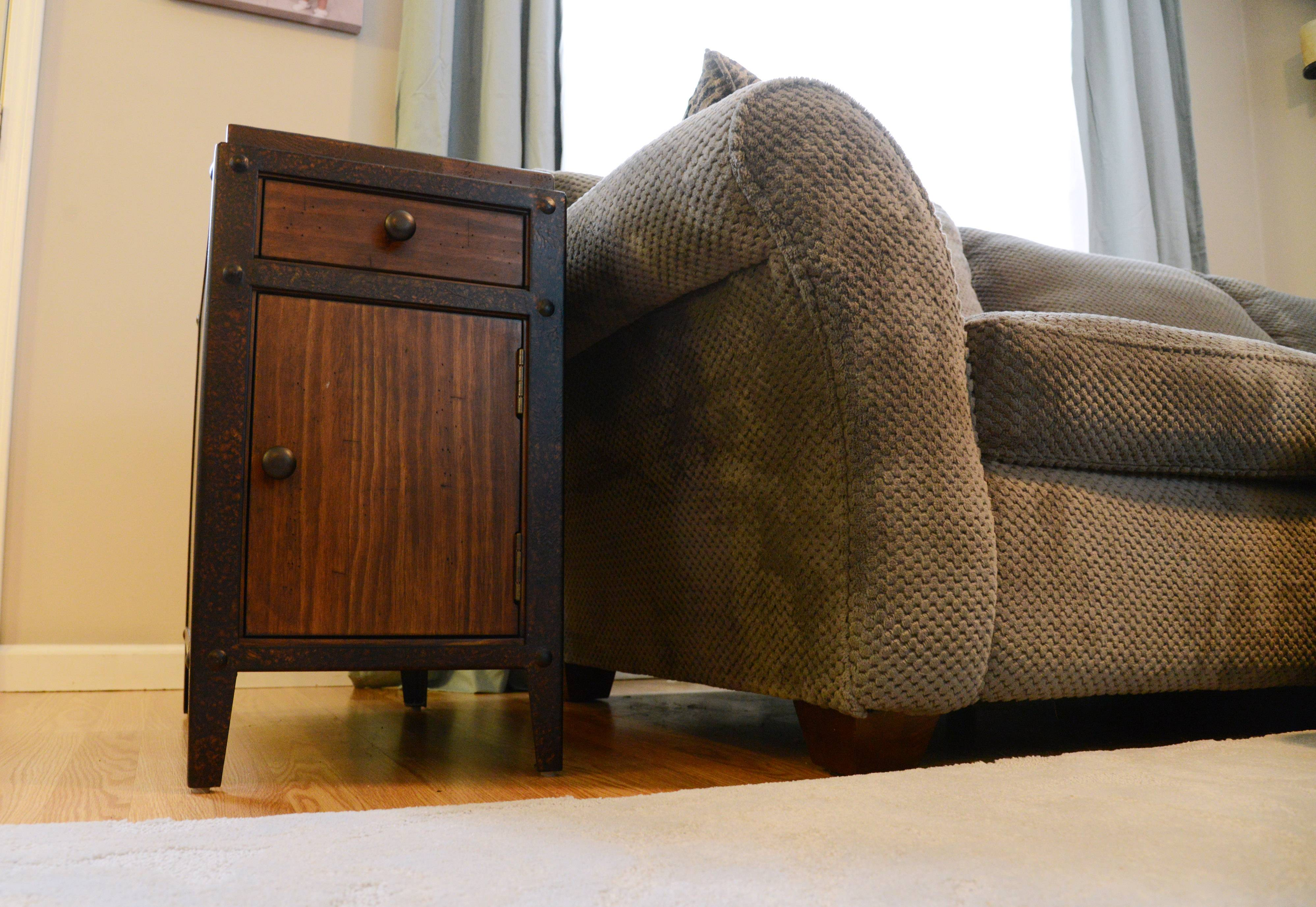A small end table sits next to the couch in the Walk family's new living room.