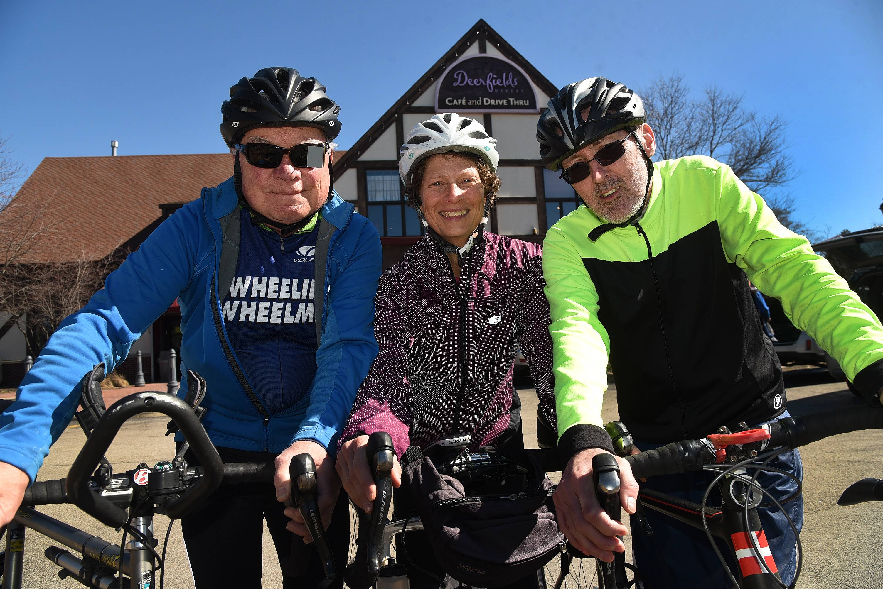From left, Joe Beemster of Wheeling, Emily Qualich of Buffalo Grove and Johannes Smits of Roselle, members of the Wheeling Wheelmen's Club, are ready for the club's St. Patrick's Day ride, which takes place March 19 in Wauconda.