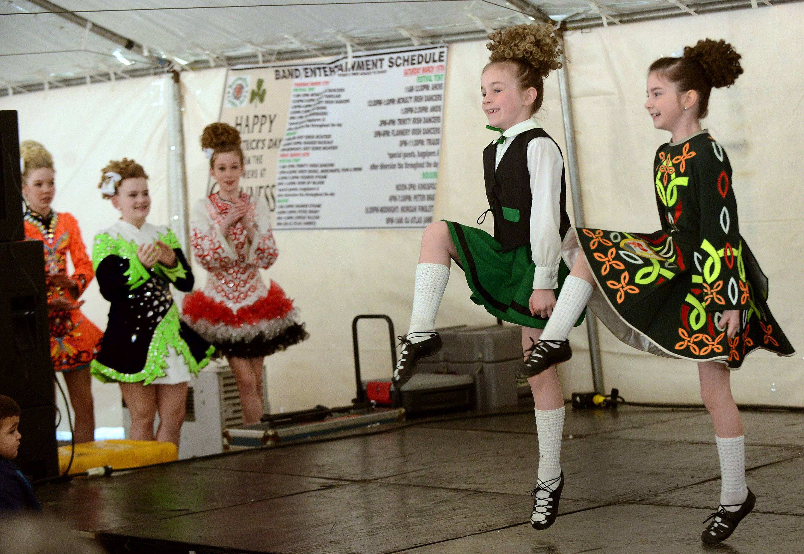 Irish dancers Emma Moran, left, and Emily Madden of the McNulty School of Irish dance perform during opening day of the 2016 Barrington Celtic Fest. McNulty is one of five Irish dance troupes performing at the festival.