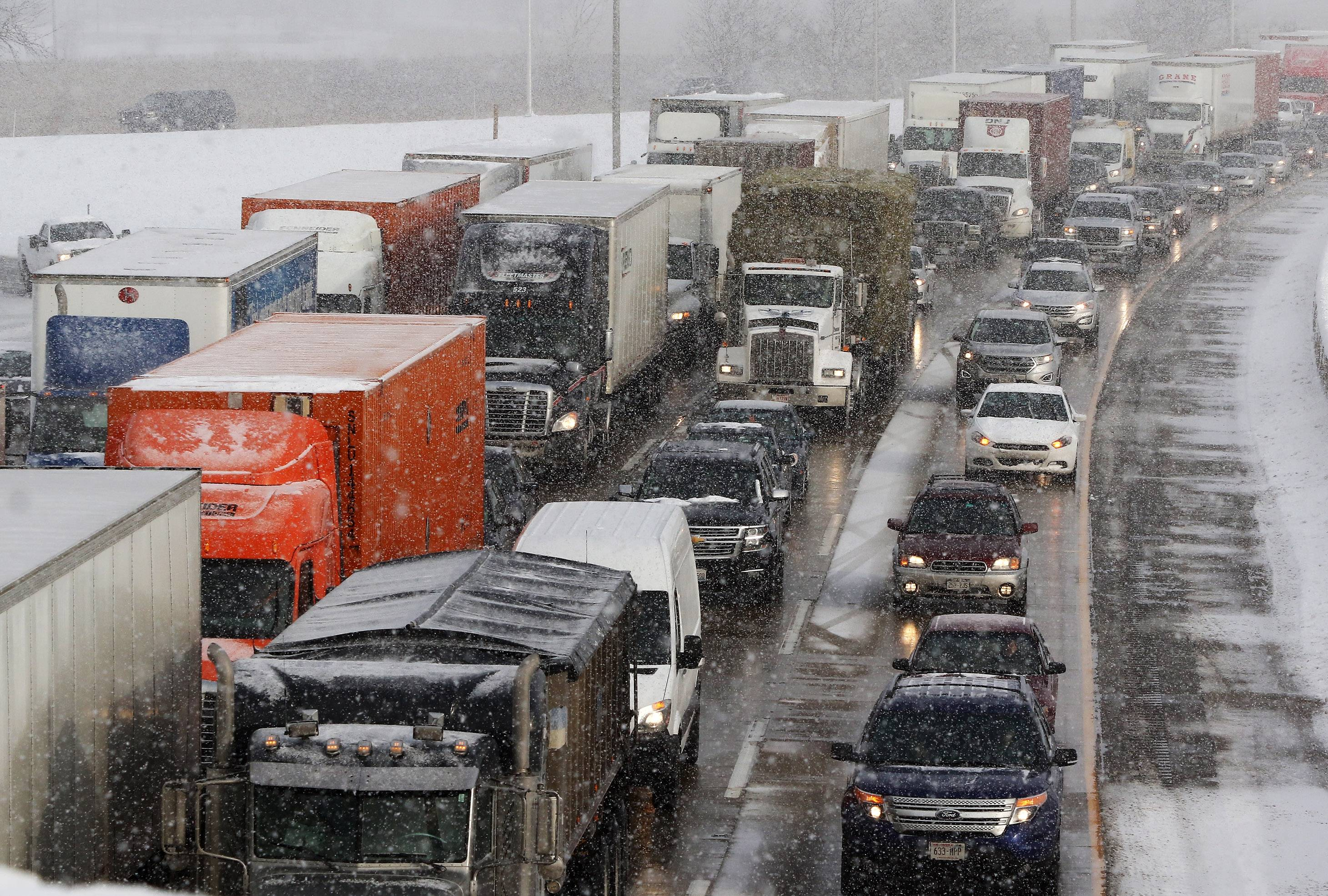 Traffic is backed up along southbound I-94 in Gurnee Tuesday after heavy snow fell overnight creating traffic nightmares in the morning.