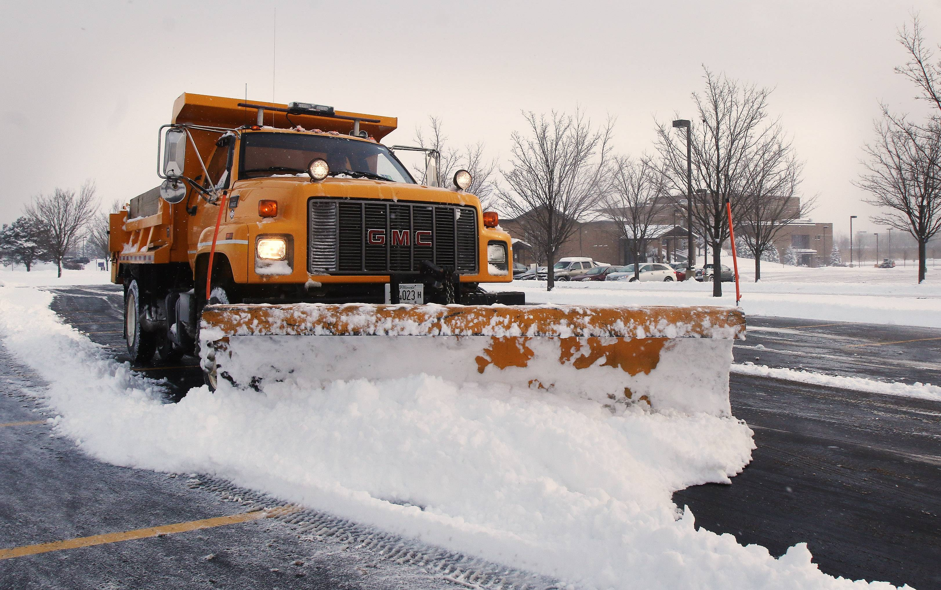 Truck driver Mike Hubers of Tovar Snow Removal clears the parking lot at Village Church of Gurnee on Tuesday. Heavy snow fell overnight creating traffic nightmares in Lake County.