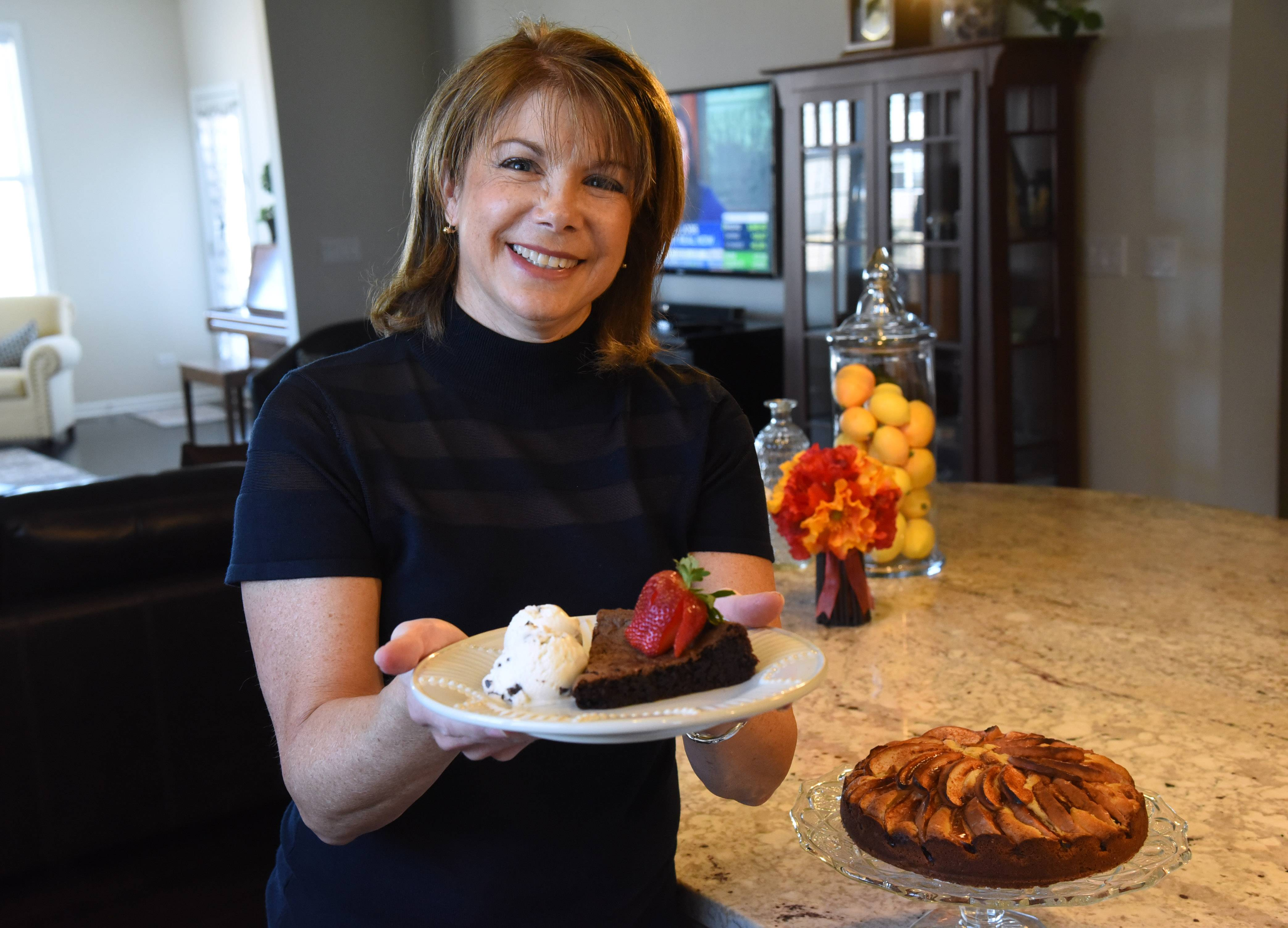 Cook of the Week Donna Abbott of Hawthorn Woods shares recipes for her signature chocolate cake with ice cream and strawberries and Italian apple cake, lower right.