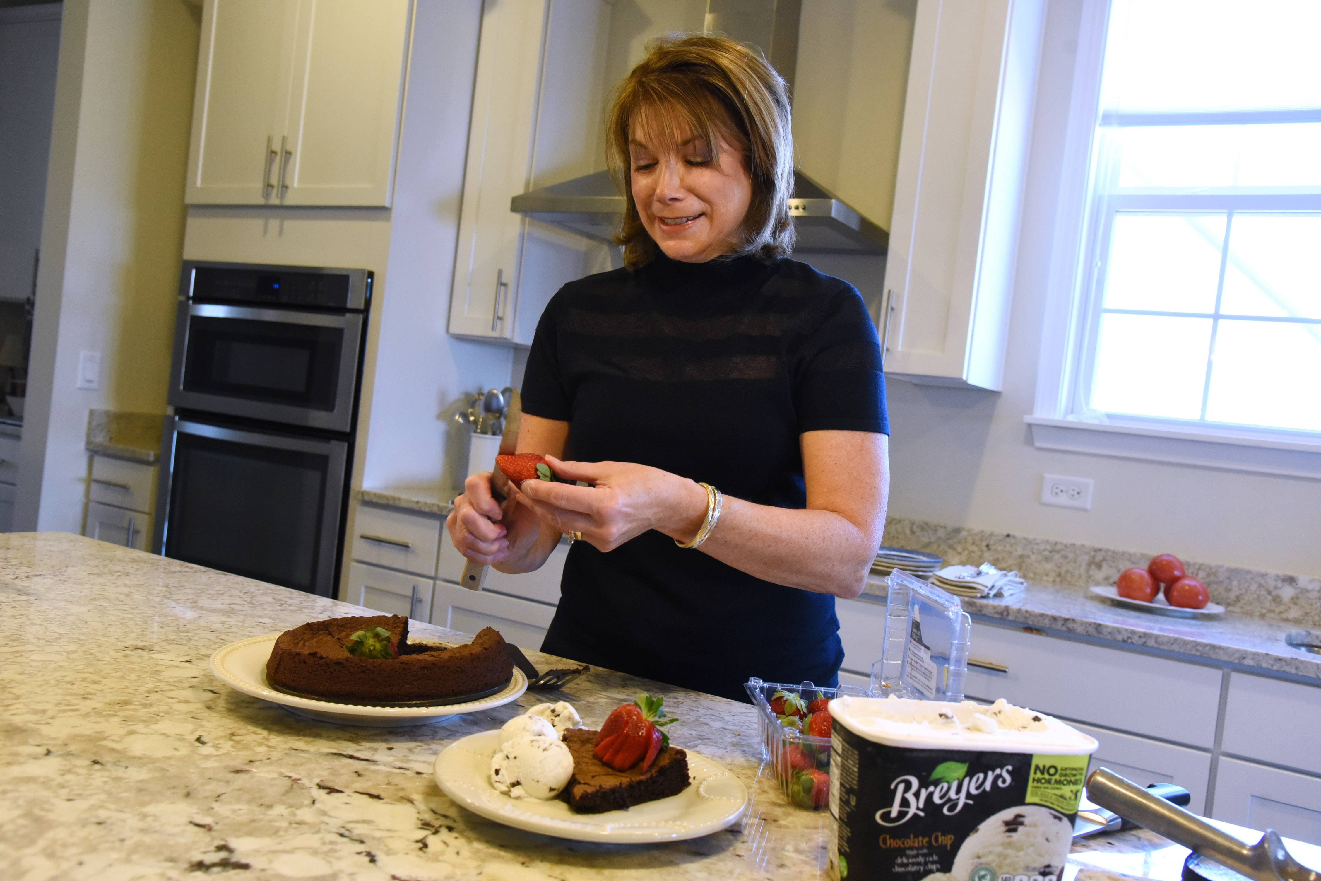 Cook of the Week Donna Abbott of Hawthorn Woods plates a piece of chocolate cake.