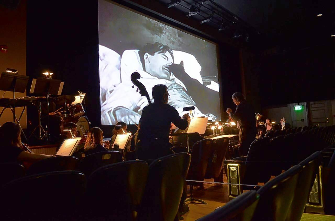 "The Lake Forest College Moving Pictures Orchestra performed recently at the Gorton Community Center to accompany the 1921 silent film ""Seven Years Bad Luck."""