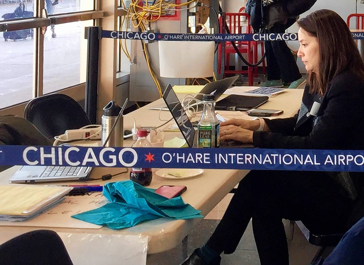 Volunteer lawyers remain at O'Hare International Airport to offer legal aid to fliers affected by travel restrictions issued by President Donald Trump but blocked by the courts.