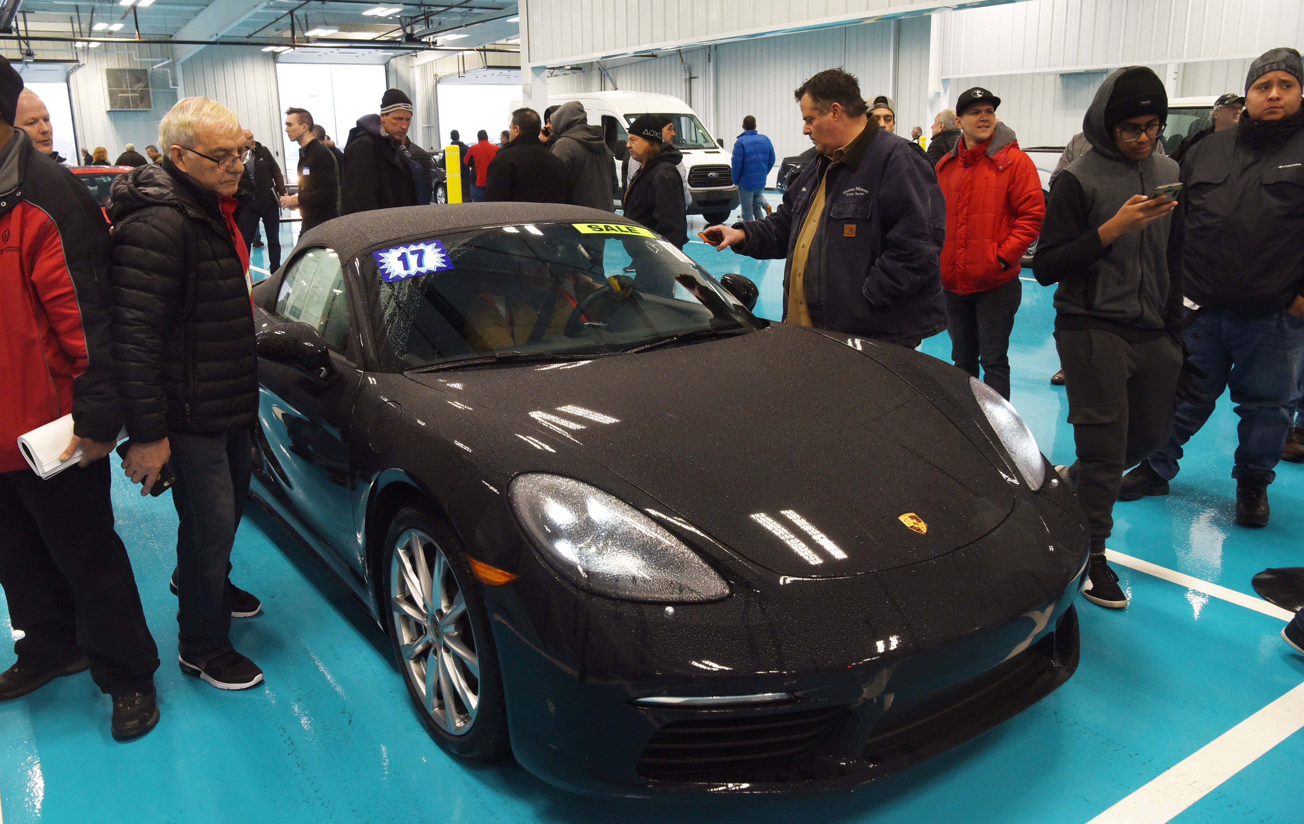 A 2017 Porsche 718 Boxter is among the 2,000 cars being sold during Friday's grand opening of the Adesa Chicago vehicle auction facility in Hoffman Estates.