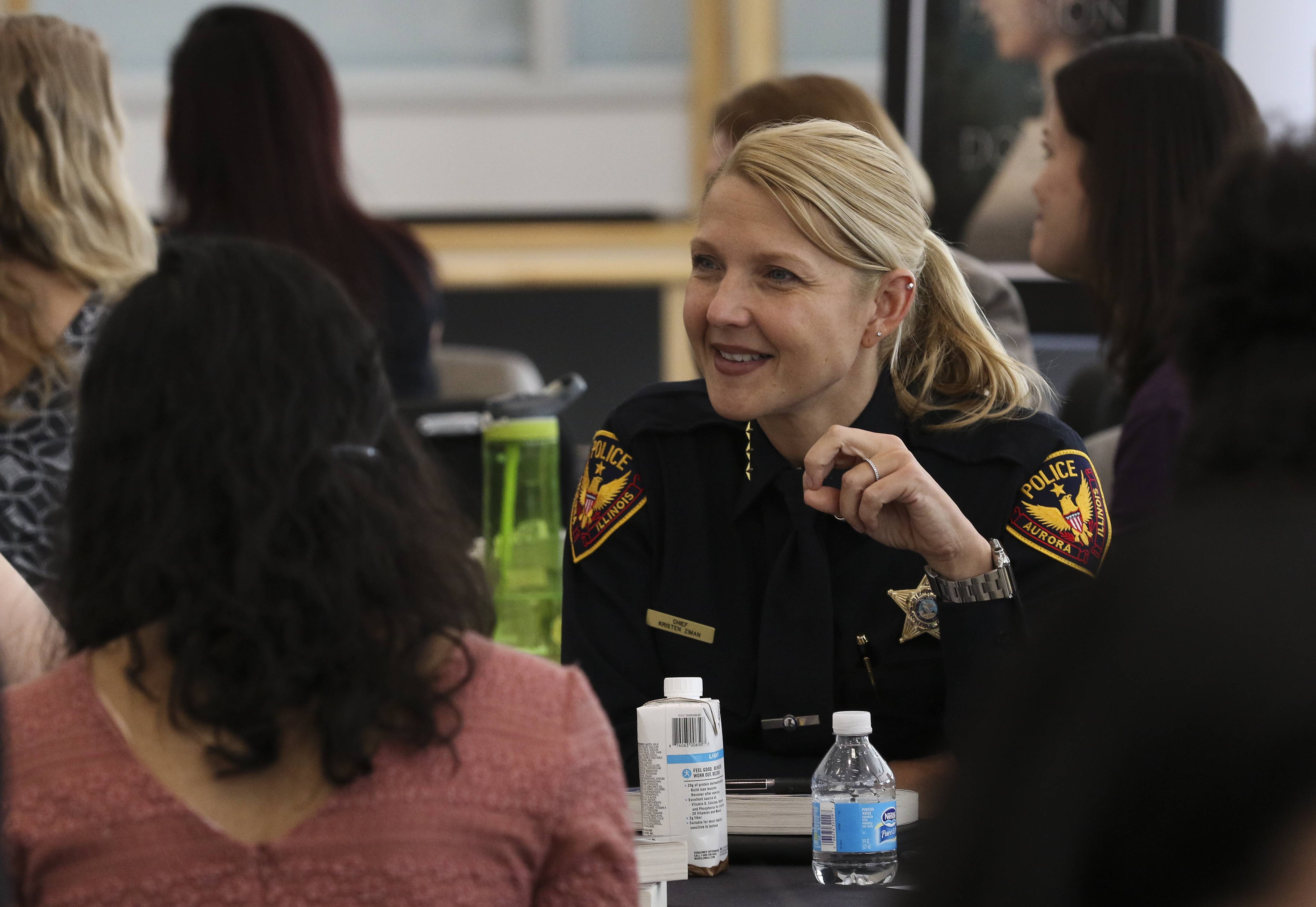 Aurora police Chief Kristen Ziman connects with students at Metea Valley High School in Aurora, where she appeared as one of four featured speakers during the school's second annual Women's History Month Workshop.