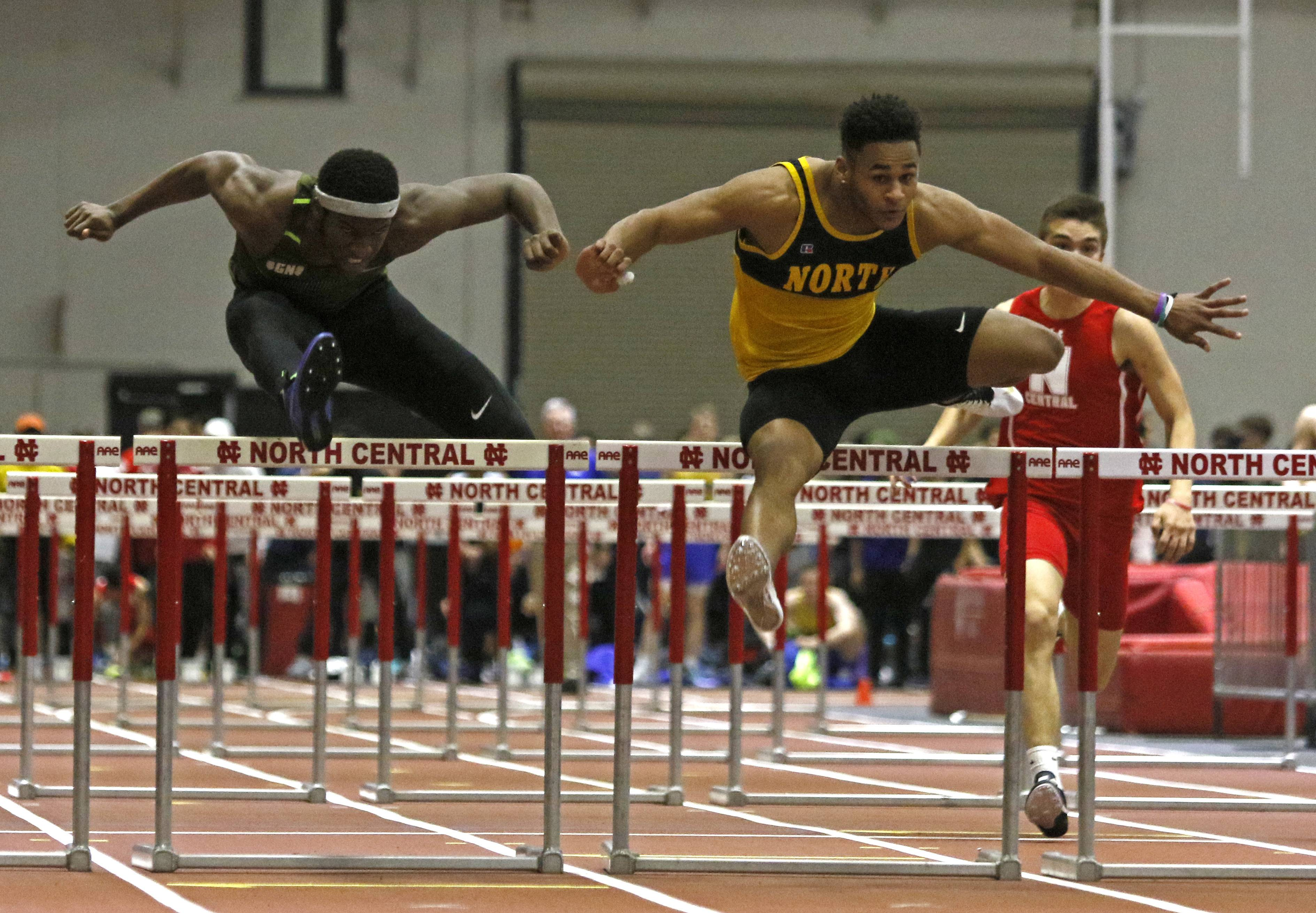 Glenbard North's Paris Miller, left, and Jace James, right, battle in the 55 meter hurdles at the DuPage Valley Conference boys indoor track meet at North Central College.